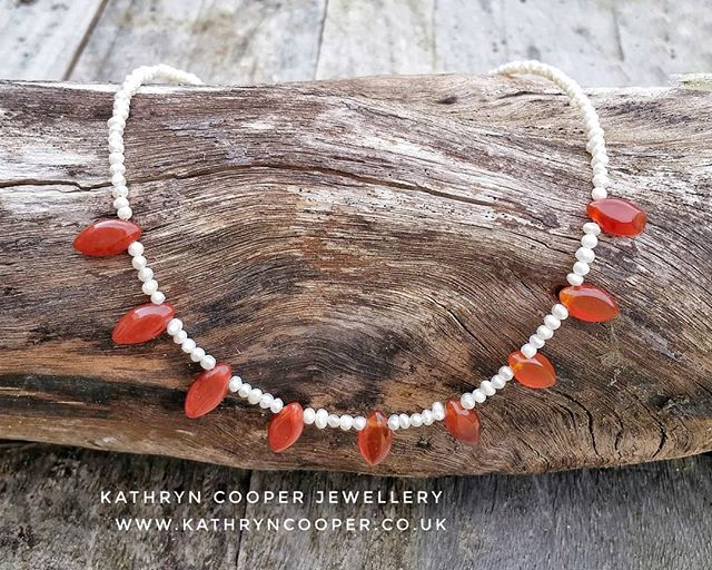 Gorgeous carnelian drops mixed with tiny freshwater pearls.  The carnelian has a smooth silky feel and has a stunning cognac colour.  Carnelian is believed to enhance creativity and sexuality, give energy and to protect against poverty. A winner!  Day 8 of  @jewellersacademy  #30daysofjewellery challenge. . . . . . . #pearls #bespokejewellery  #whitepearls #jewelleryshopping #pearljewellery #jewelleryaddict #hmuk #tinypearls #seedpearls #madeinbritain #carnelian #ukblogger  #kathryncooperjewellery #blogger  #weddingjewellery #myjewelleryfamily  #carnelianjewellery #outfitinspiration  #jewelleryinfluencer #whattowear #wswib #hlhjune #giftsforher #birthdaygift  #jewellerylover #beadedjewelryofinstagram #beadedjewelryinfluencer #junebirthstone