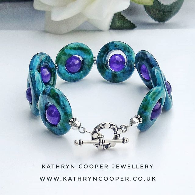 I've not been very good at posting enough for the @jewellersacademy  #30daysofjewellery challenge. Never mind, here's my day 14.  This is the bracelet part of a set with matching earrings and necklace to follow.  Chrysocola with purple dyed quartz crystal. I love this set so much I might have to keep it. 💙💚💙💚💙💚💙 . . . . . . #chrysocola #dyedquartz  #bespokejewellery #purple  #jewelleryshopping #jewelleryaddict #hmuk  #madeinbritain  #ukblogger #kathryncooperjewellery #blogger  #myjewelleryfamily  #oneoffjewellery #outfitinspiration  #jewelleryinfluencer #whattowear #wswib  #giftsforher #birthdaygift  #jewellerylover #beadedjewelryofinstagram #beadedjewelryinfluencer