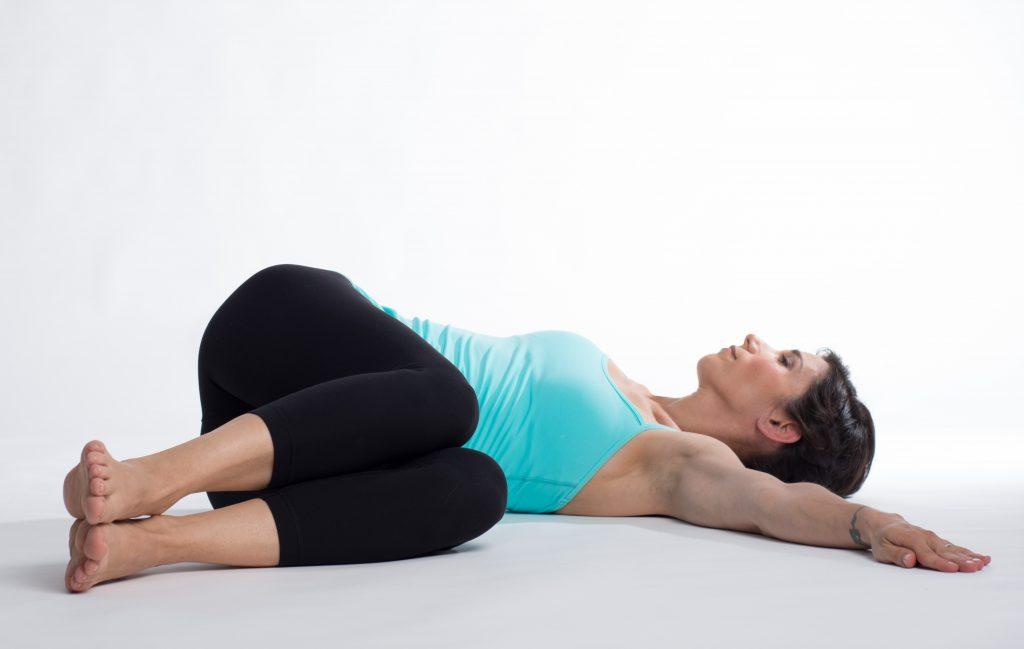 reclining twist yoga albergo miramonti.jpg