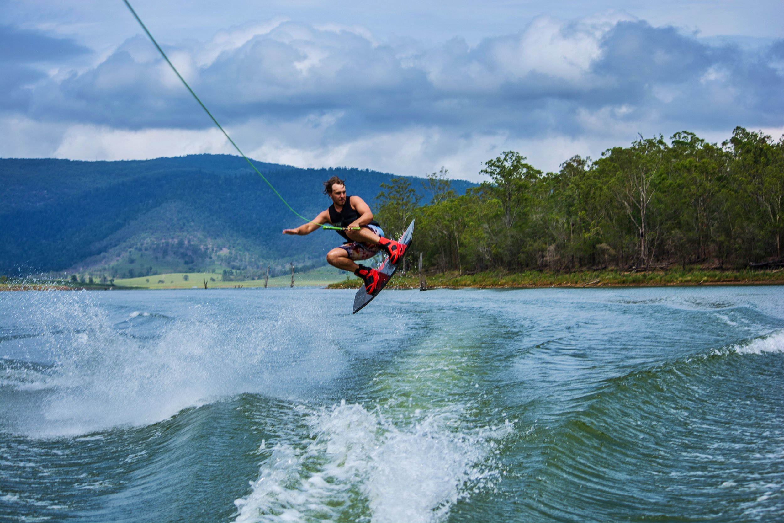 Water skiing on a lake.