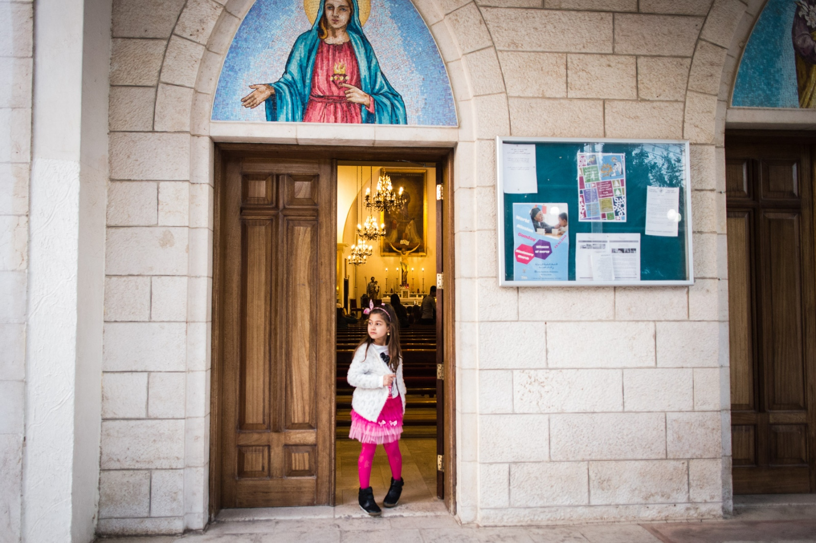 Valentina, 7, stands in the doorway of the Mar Youssef church in Amman, Jordan, on Nov. 4, 2016. She has lived in Amman with her family since fleeing Mosul over a year ago when ISIS took over.