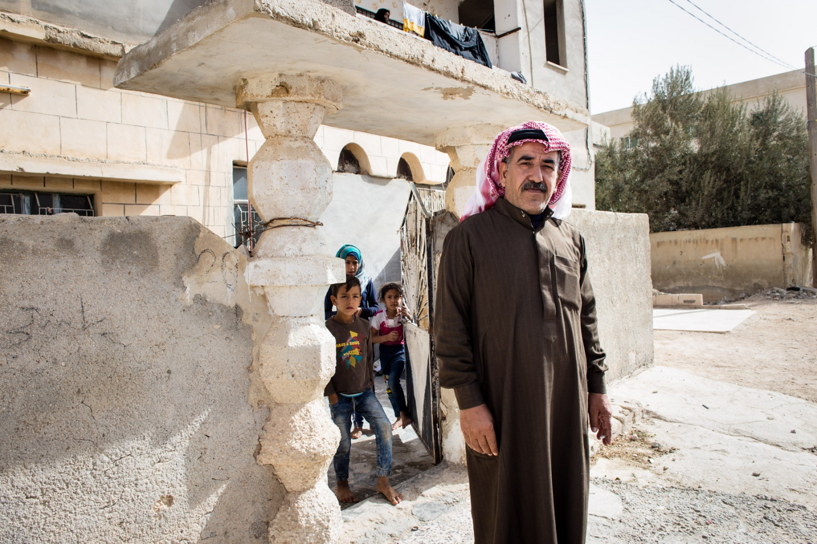 Abu Mohammed, 48, from Aleppo, lives in Mafraq, Jordan. He has two wives, and with his children and other relatives, he is responsible for taking care of about 30 people in his household. The family can't afford to pay for work permits, so he and his older sons do odd jobs in construction and agriculture to earn a living.