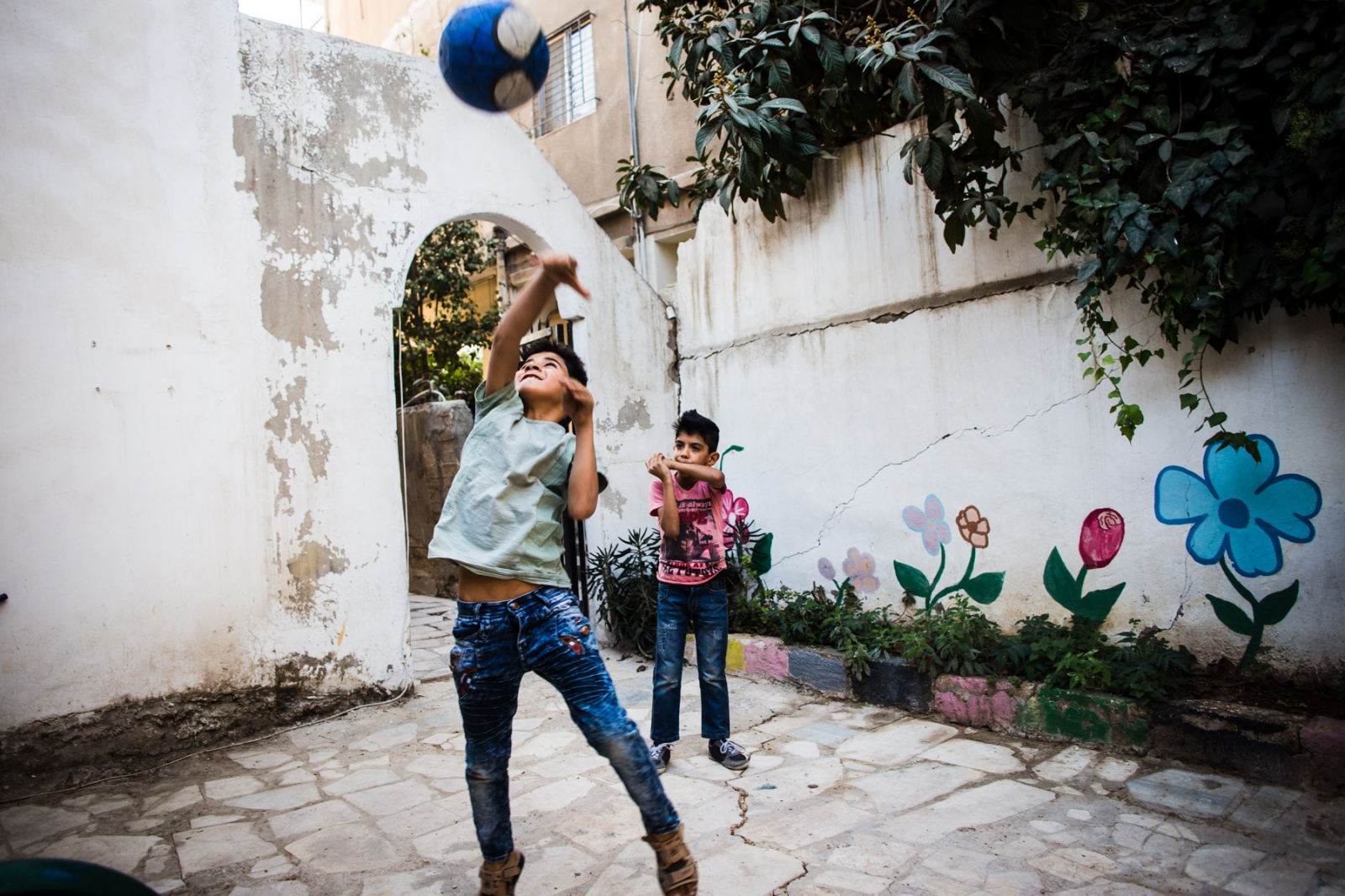 Iraqi and Syrian children play together at Collateral Repair Project's community center in Amman, Jordan.