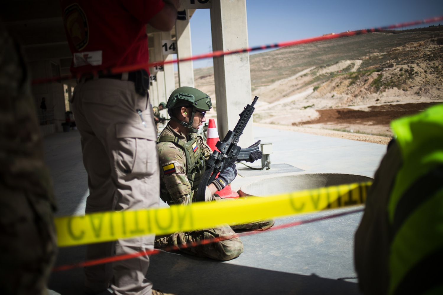 The Colombia team participates in the desert stress shoot event in the seventh annual Warrior Competition at the King Abdullah II Special Operations Training Center near Amman, Jordan, on April 21, 2015.