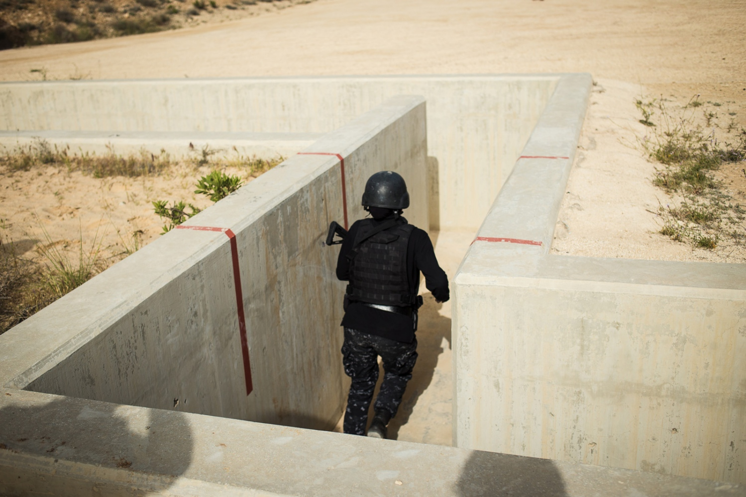 The all-women's Unit 30 SWAT Police team from Jordan competes in the three-gun gauntlet during the seventh annual Warrior Competition at the King Abdullah II Special Operations Training Center near Amman, Jordan, on April 20, 2015.