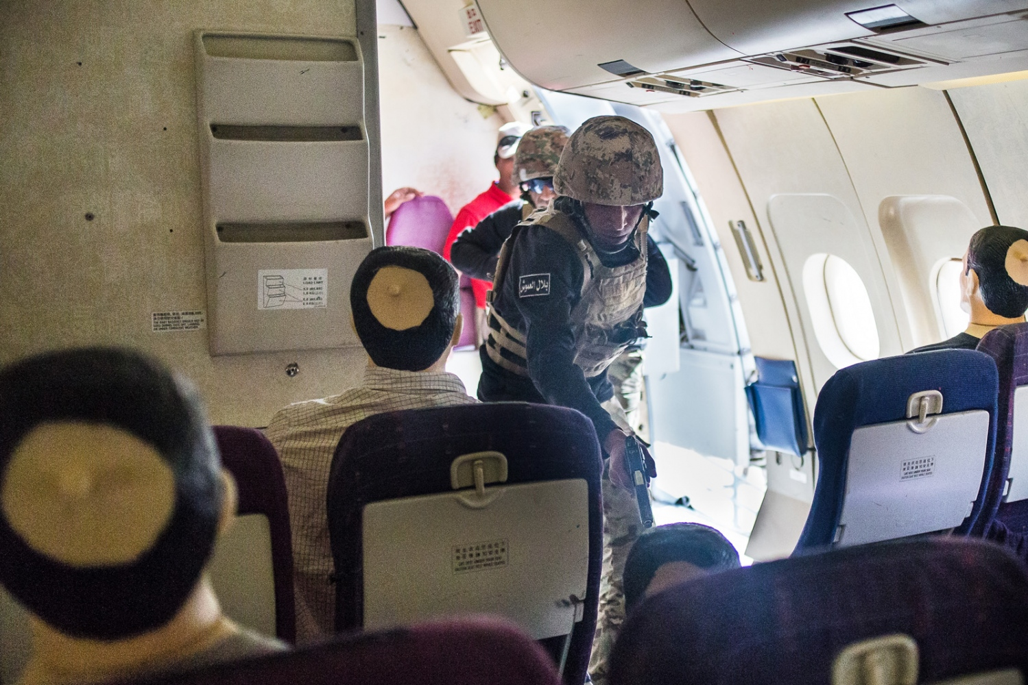 The Jordan team participates in the Airbus seizure event, demonstrating how to execute a target onboard a passenger aircraft. The exercise was part of the seventh annual Warrior Competition at the King Abdullah II Special Operations Training Center near Amman, Jordan, on April 21, 2015.
