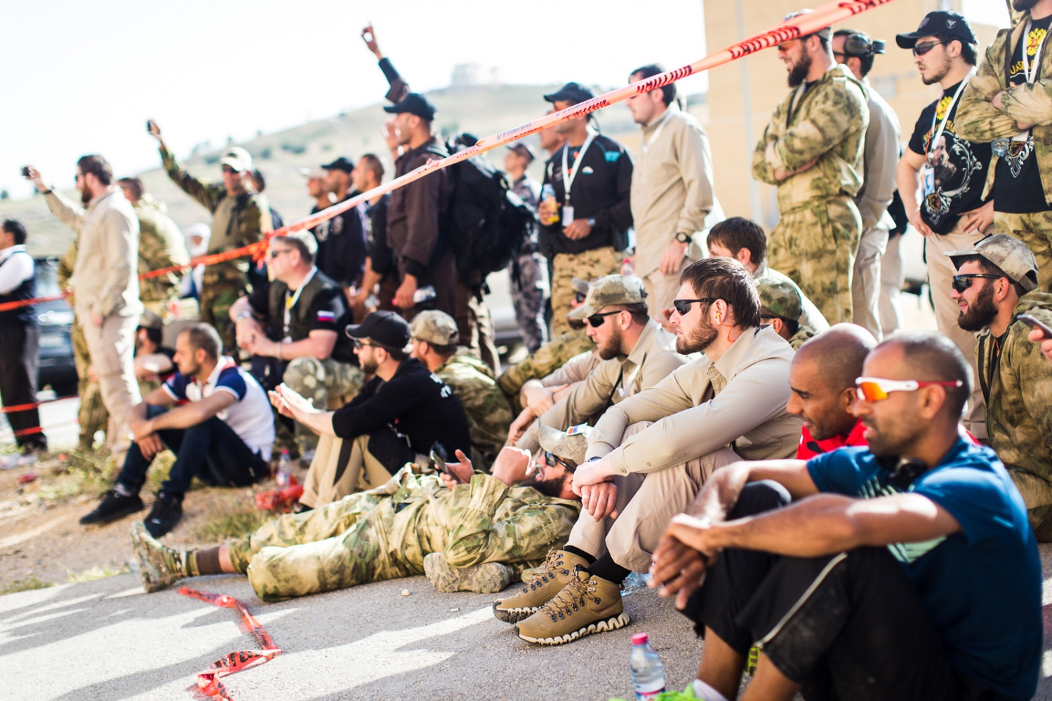 "Teams from various countries relax together and cheer on their teammates during the first event of the Warrior Competition, ""Top Gun."" Elite counter-terrorism teams from around the world compete for the title of champion at the King Abdullah II Special Operations Training Center near Amman, Jordan."