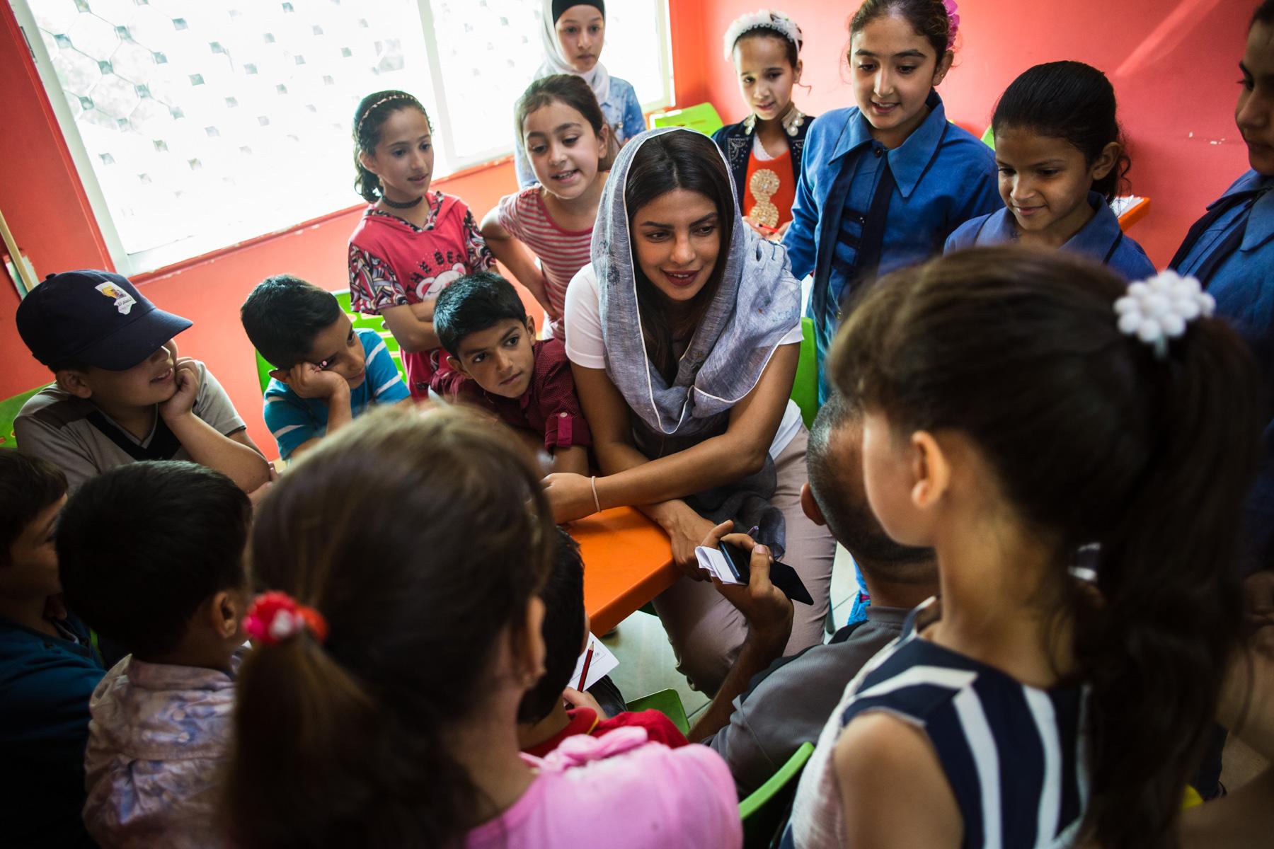 Priyanka Chopra, a UNICEF Goodwill Ambassador, meets with children at UNICEF's Makani Center in Amman, Jordan, on Sunday, Sep. 10, 2017. (AP Photo/Lindsey Leger)