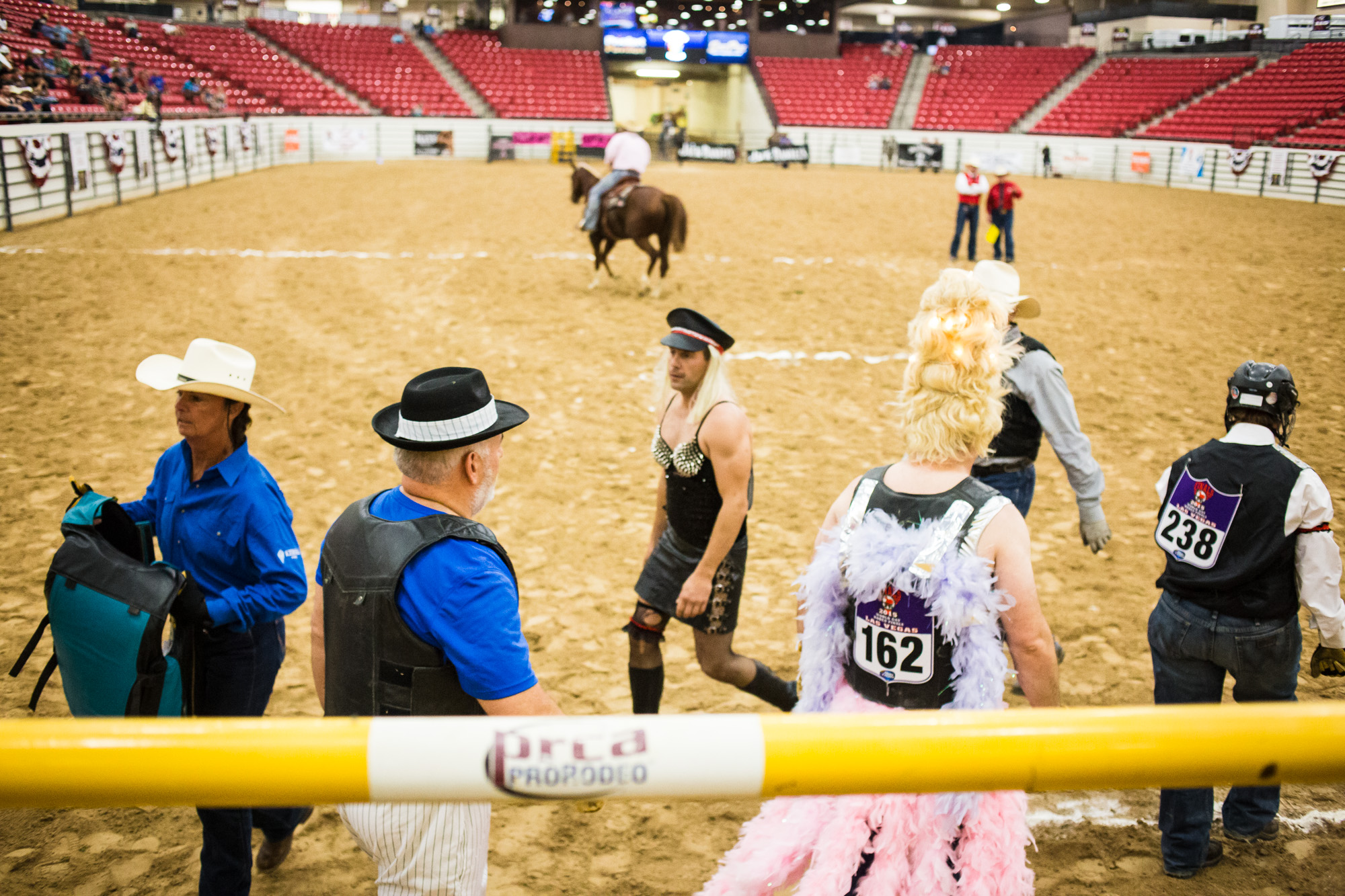 The Wild Drag Race is an event unique to the Gay Rodeo, which involves a 3-person team of a man and woman in costume, plus either a man or woman in drag. With the help of his/her teammates, the person in drag must try to mount a bucking steer after being released from the chute.