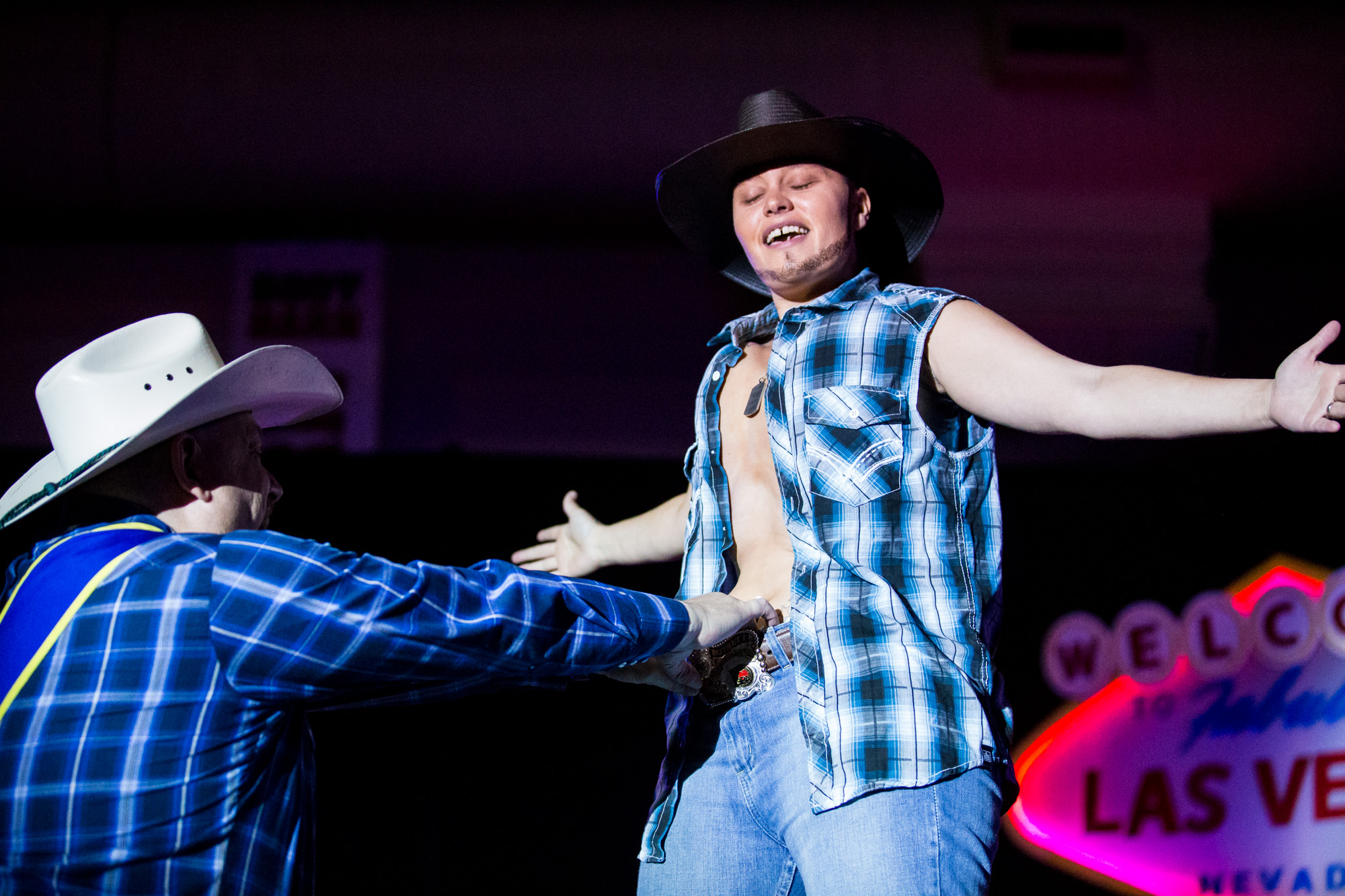 "Charlie, aka Preston, MsTer IGRA 2014, performs a song and dance routine at the World Gay Rodeo Finals in Las Vegas, NV. She started coming to the gay rodeo four years ago, but has been doing drag for nine years. Preston's song of choice was ""She Thinks my Tractor's Sexy,"" by Kenny Chesney."