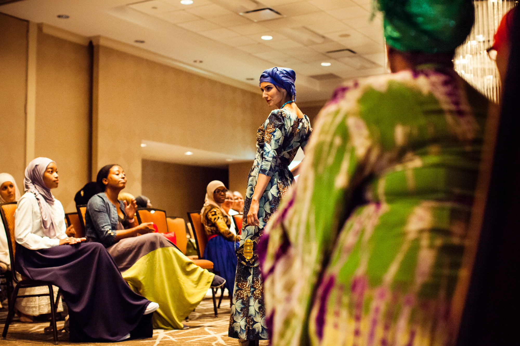 Model Lilly Matini pauses to strike a pose at the Reaching All HIV+ Muslims in America (RAHMA) fashion show in Washington, DC on Aug. 16, 2014.
