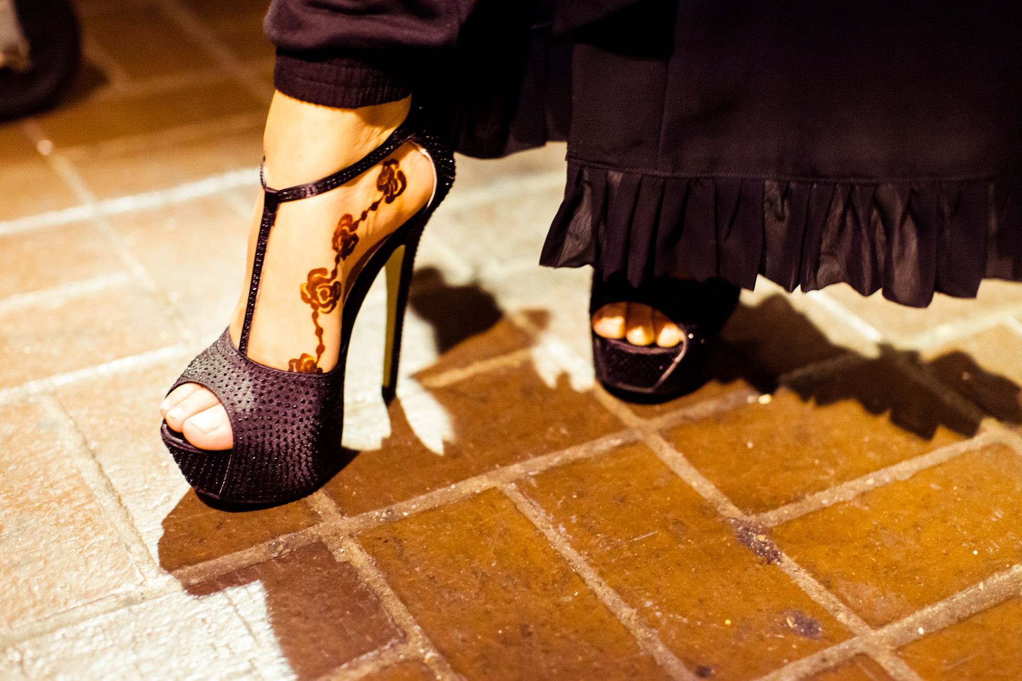 A model shows off her henna tattoo with her stilettos backstage at the RAHMA fashion show in Washington, DC.