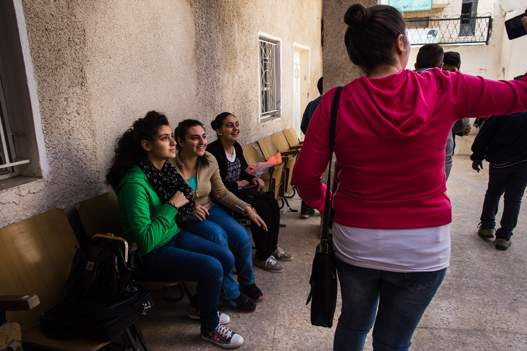 Jordanian Christian youth play and socialize outside an Orthodox Church in Mafraq, Jordan, on Nov. 4, 2016. About four months ago, the church started an educational program for kids, and quickly took in young Syrian refugees - whether Christian or Muslim - to make sure the kids are getting a good basic education, even if they aren't able to attend school.