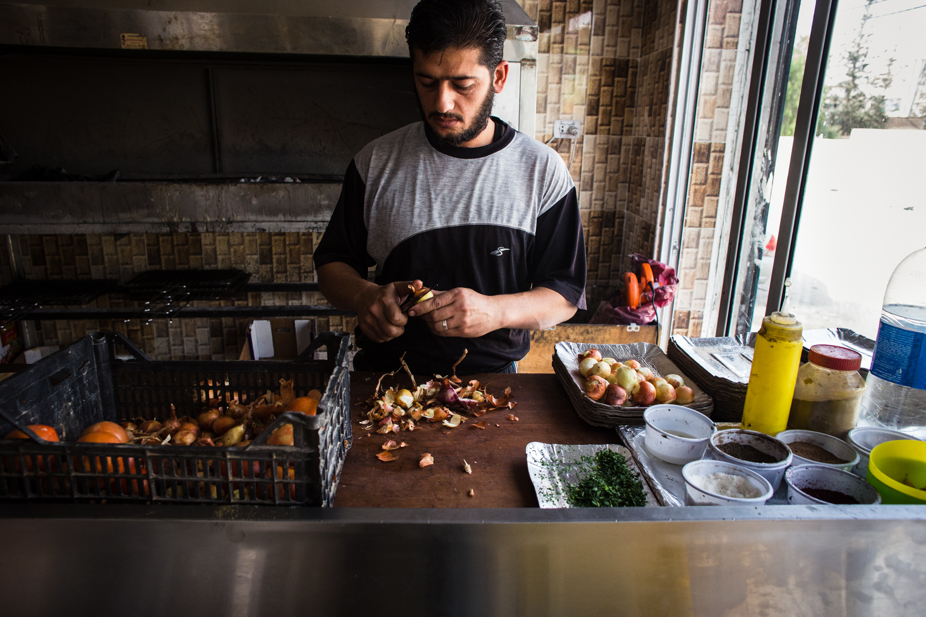 Abu Hamad (not pictured), a Jordanian citizen, owns a butcher shop in Mafraq city and employs four Syrian refugees. He paid for all of their work permits so that they could work legally in Jordan.