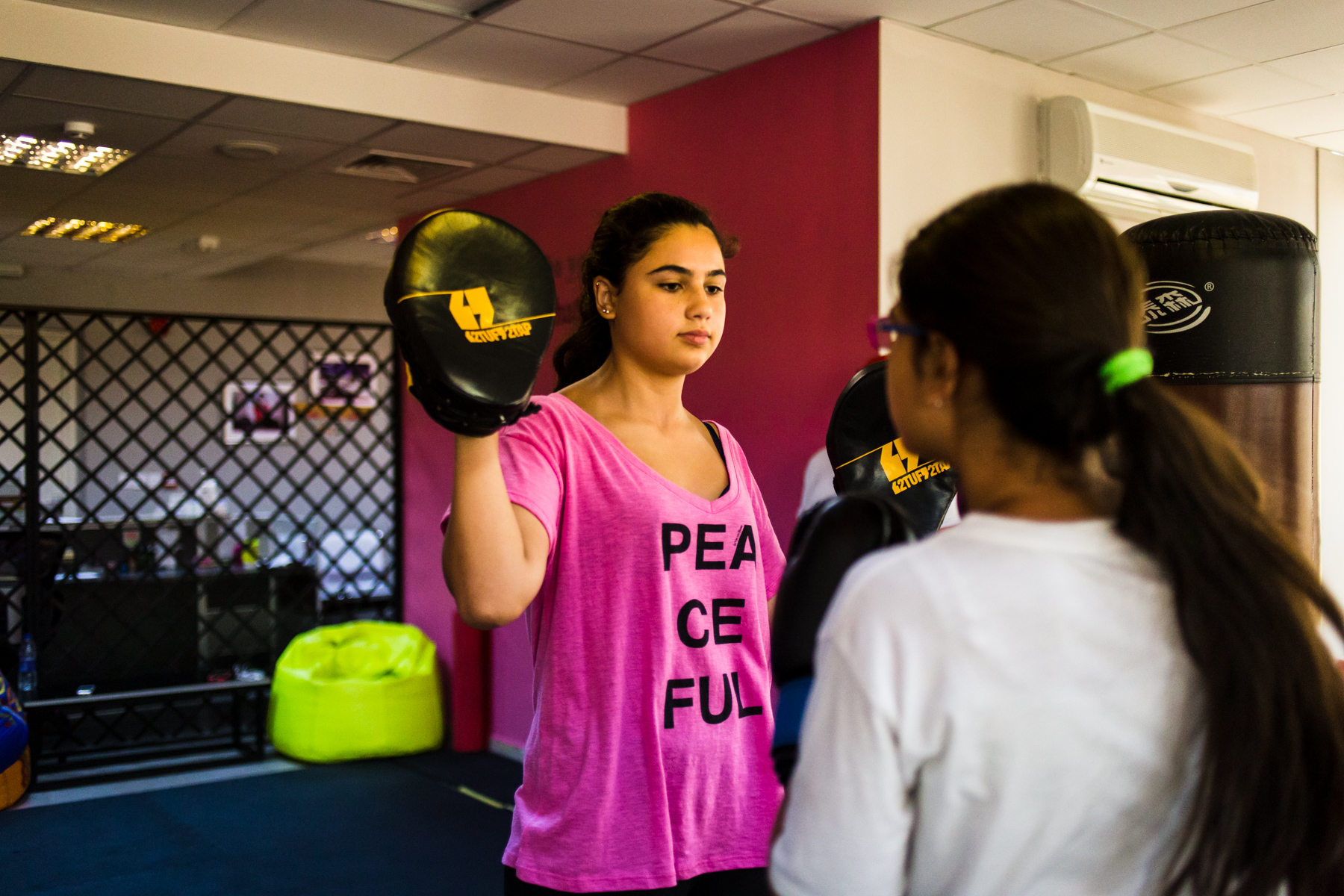 Zaina and Juwana Ghosheh practice high kicks during a self defense course at She Fighter in Amman, Jordan, on August 21, 2015. The She Fighter studio was founded by Lina Khalifeh, and offers self defense classes to young women to protect against harassment.