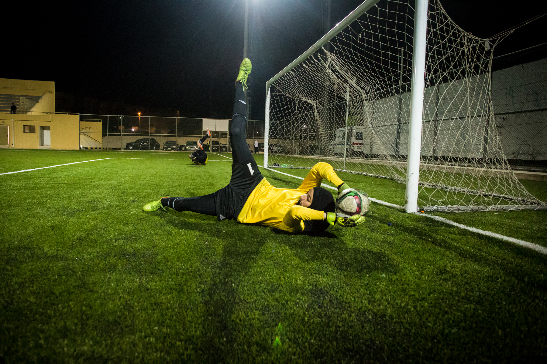 Rand Al-Bustanji dives to save a goal.