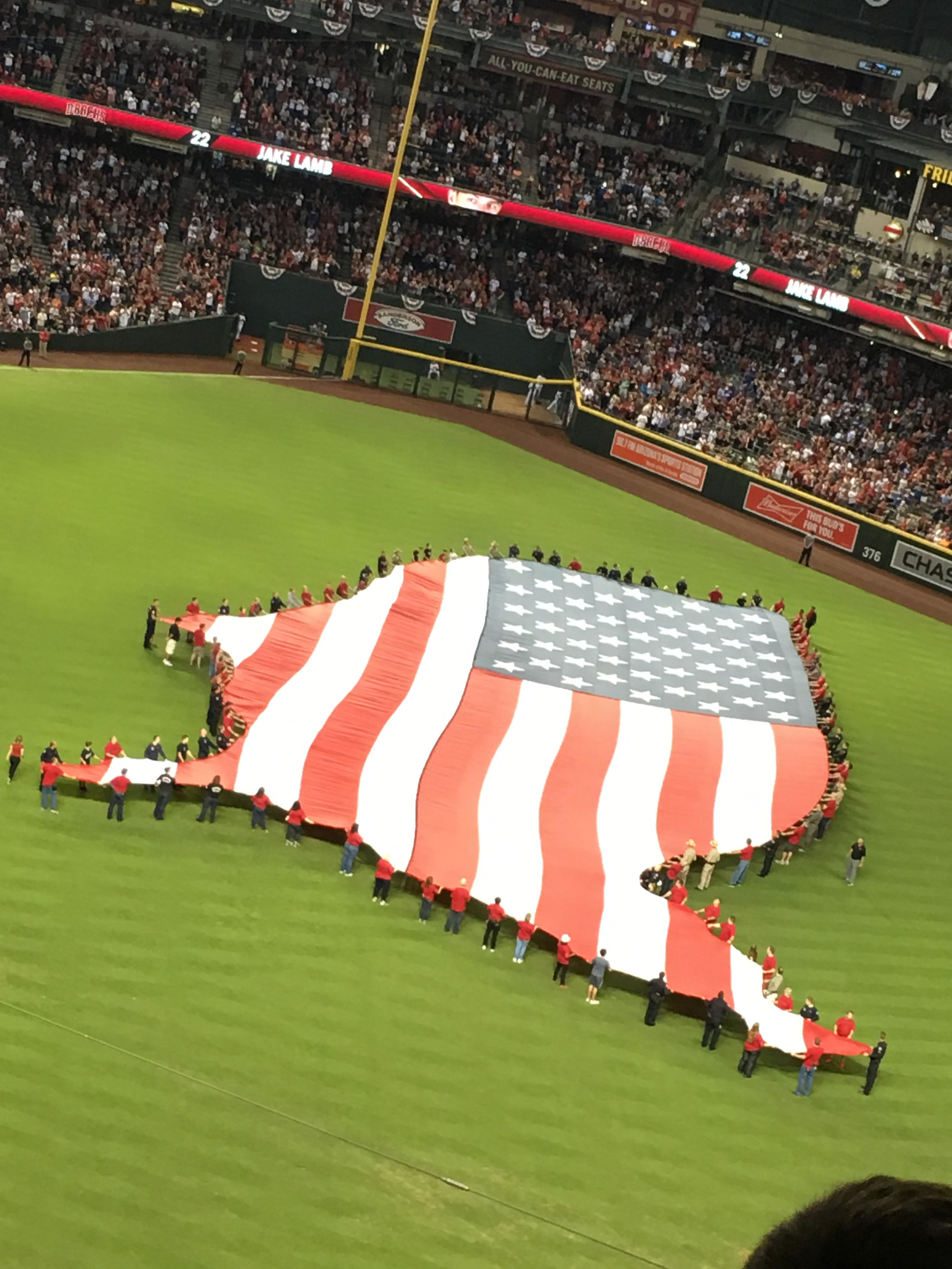 It was only fitting to have a beautiful American flag in the shape of our country for the national anthem just before the greatest Olympic athlete threw out the first pitch!