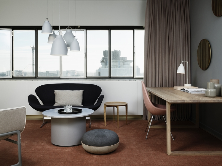 Swan Sofa, Drop Chair, Essay Table, and Caravaggio Read Table Lamp with accessories from Fritz Hansen.