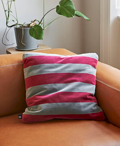The Soft Stripe Cushion collection comprises an assortment of colourful velvet cushions in contrasting stripes.