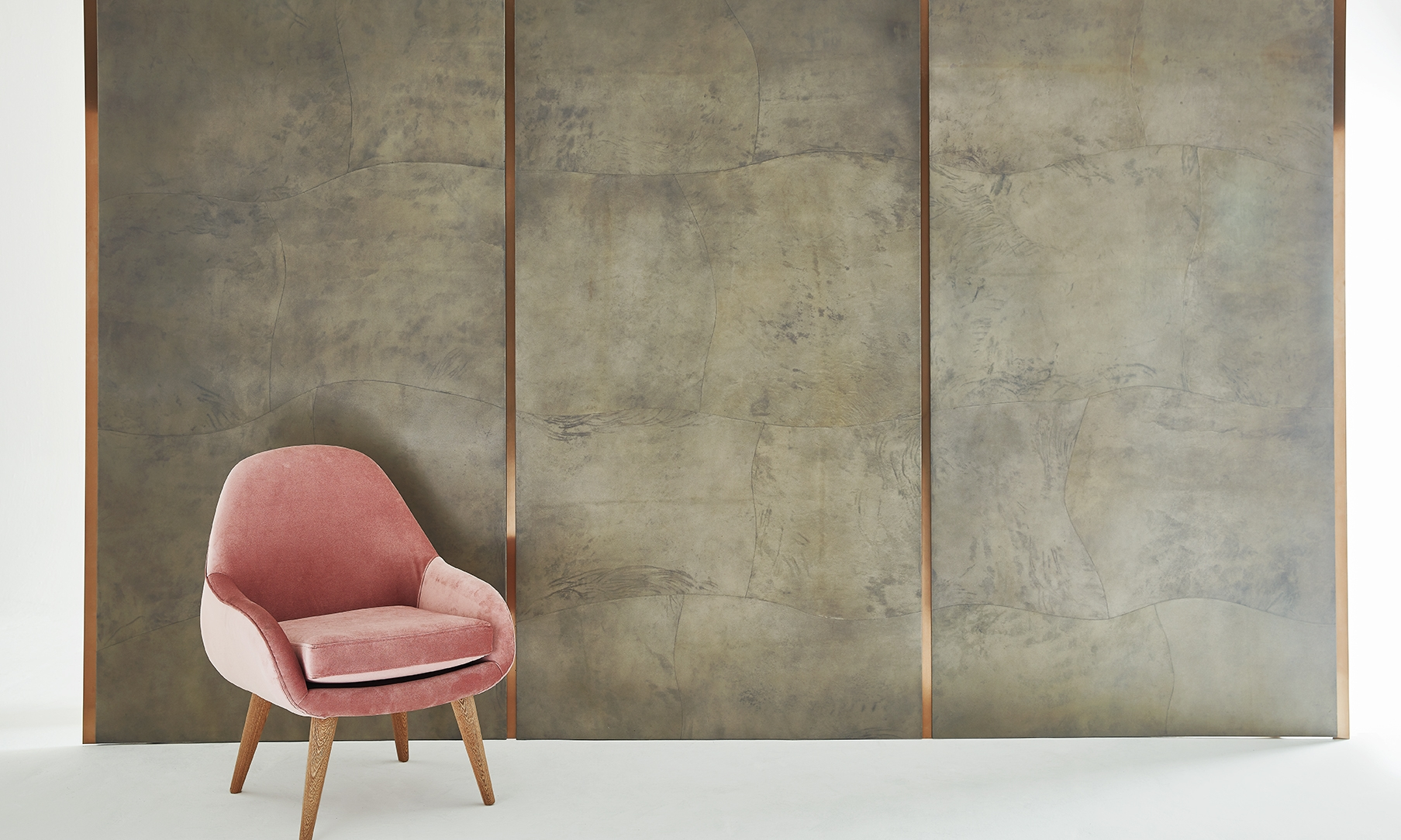 Jimeco architectural finishes shown in: pearlized concrete parchment with copper reveals