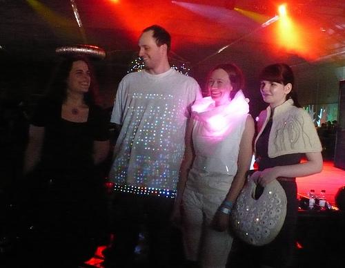 From left to right:   Skirt Full of Stars  by Shannon Henry, LED vest by Erik Johnson,  GER: Galvanic Extimacy Responder  by Kristin Neidlinger,  Soft Electric Capelet and Sessile Handbag  by Grace Kim