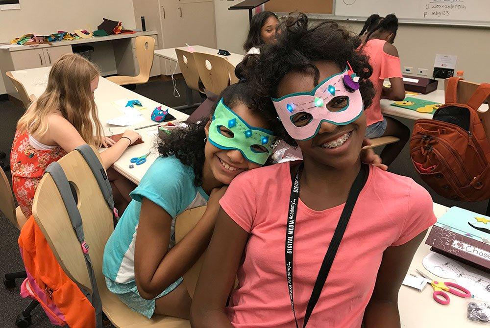 Made-by-Girls participants pose with    light up masks   . Image courtesy of Digital Media Academy.