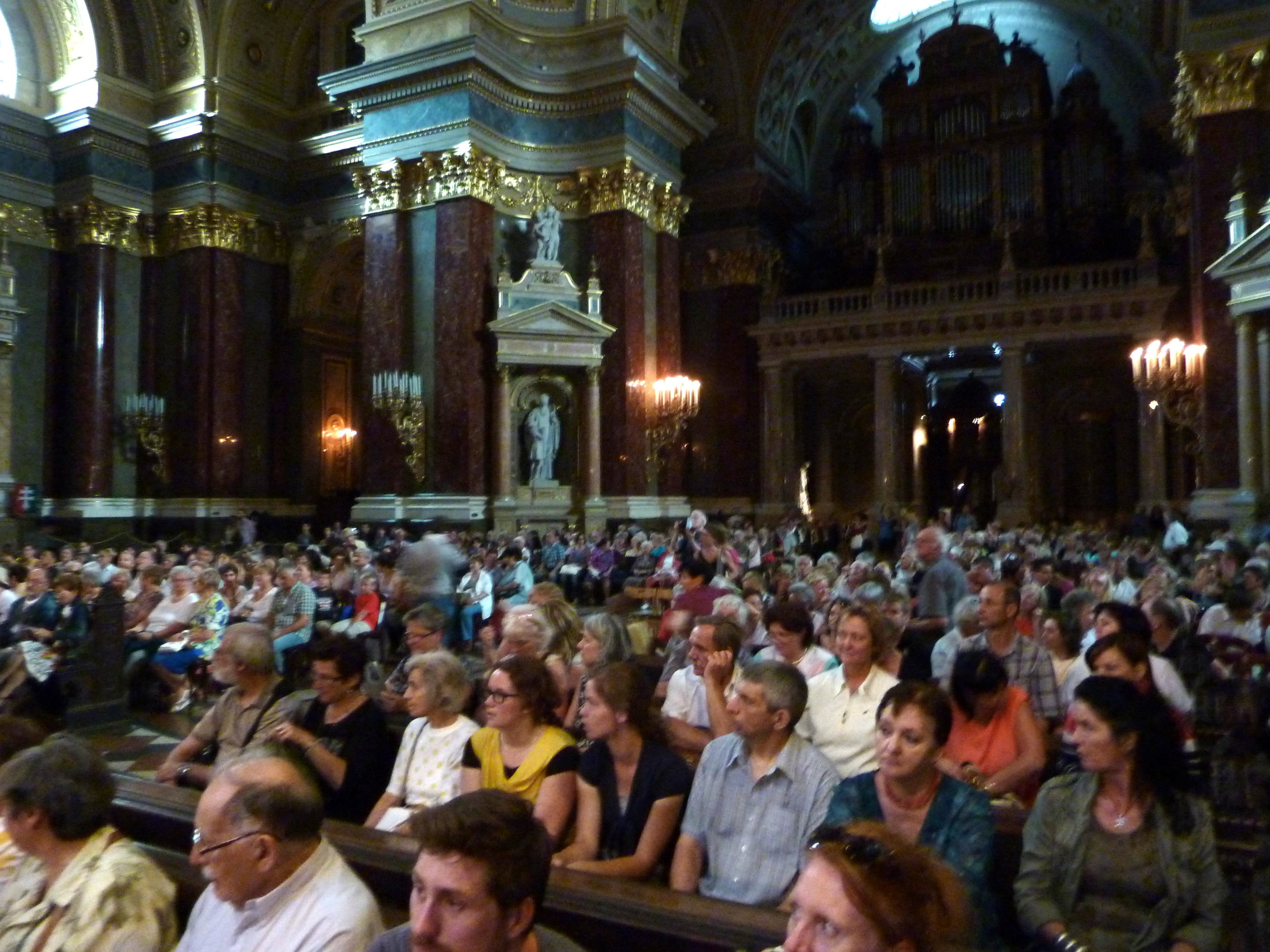 Audience is arriving for Metropolitan Flute Orchestra concert at St. Stephen's Basilica in Budapest, Hungary