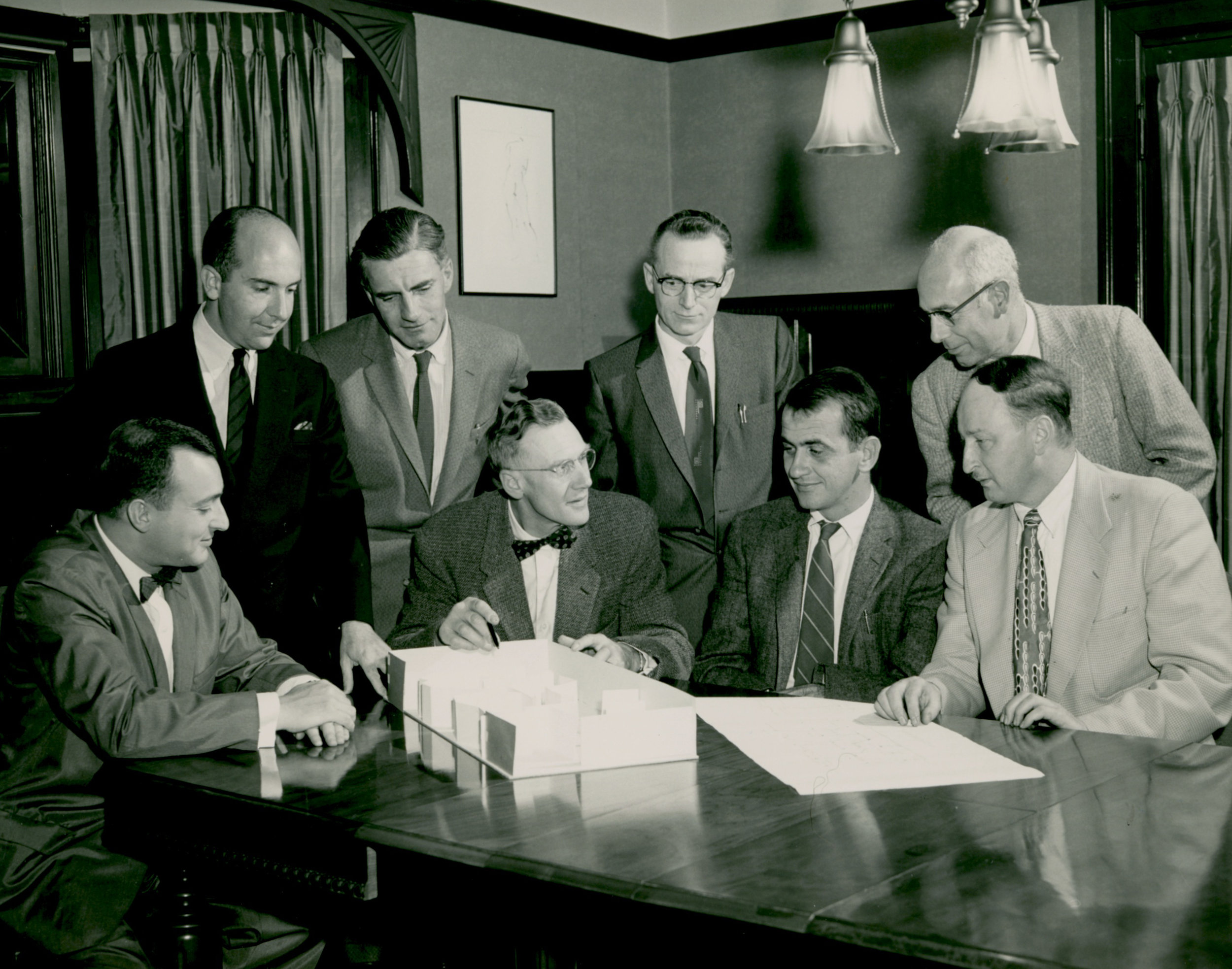 Charles Politz (standing left) planning the Oregon Centennial exhibition