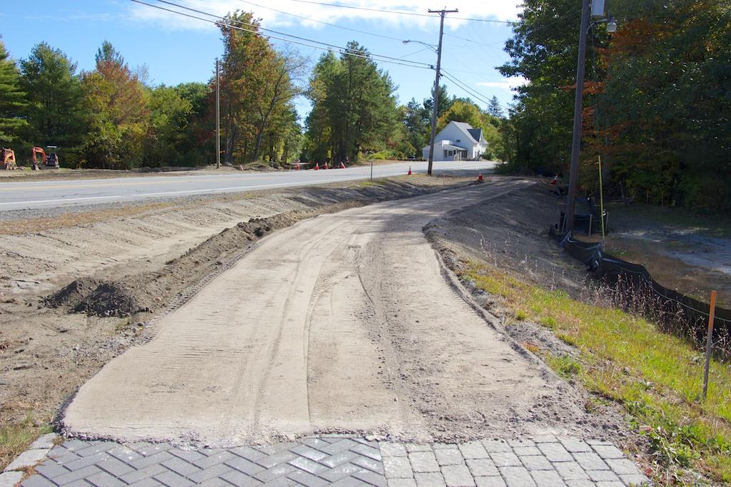 Newly laid gravel awaits smoothing near Pro Landscape