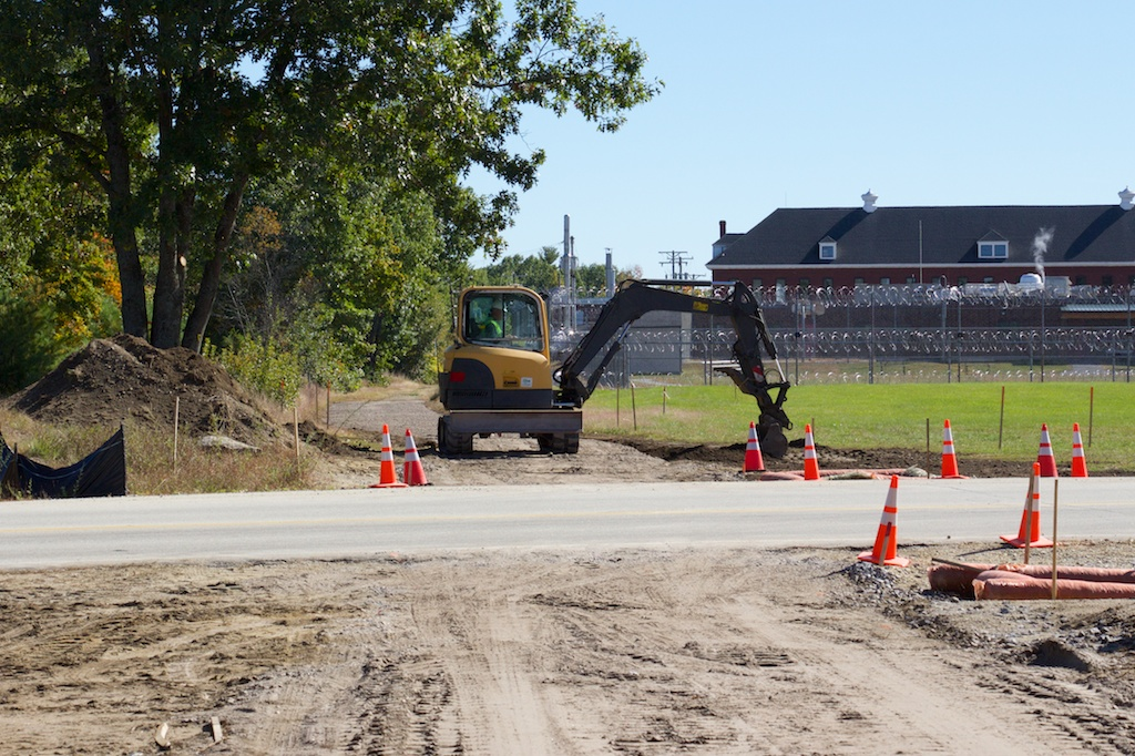 Smoothing the new gravel surface near Henry Bridge Road