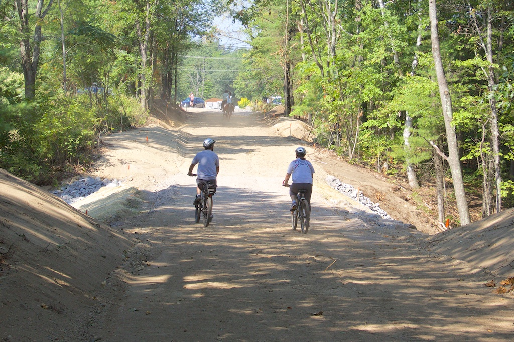 Eager trail users crossing former Henry Bridge Road gully