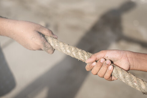 two hands pulling rope.jpg