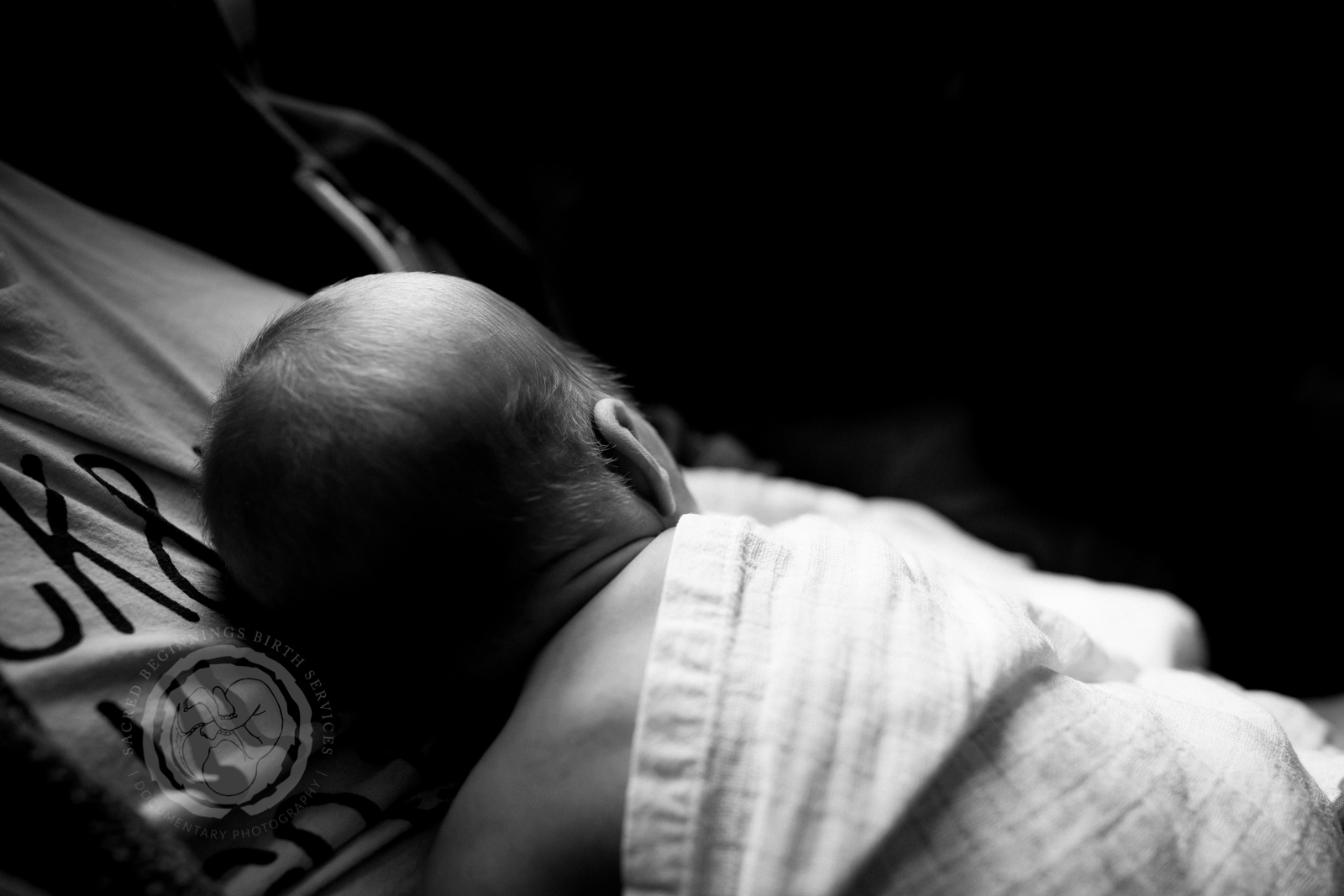 Newborn baby napping on dad's chesting during a fresh 48 photography session in Derbyshire, UK.