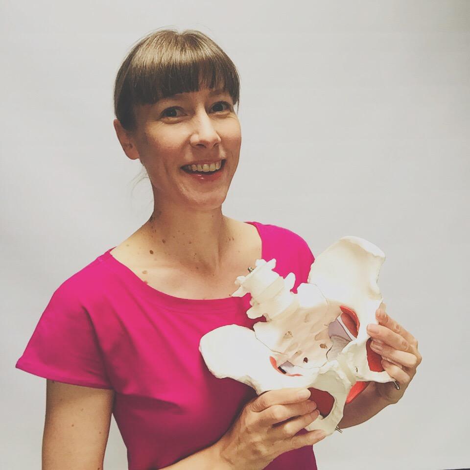 Claire Mockridge holding a pelvis