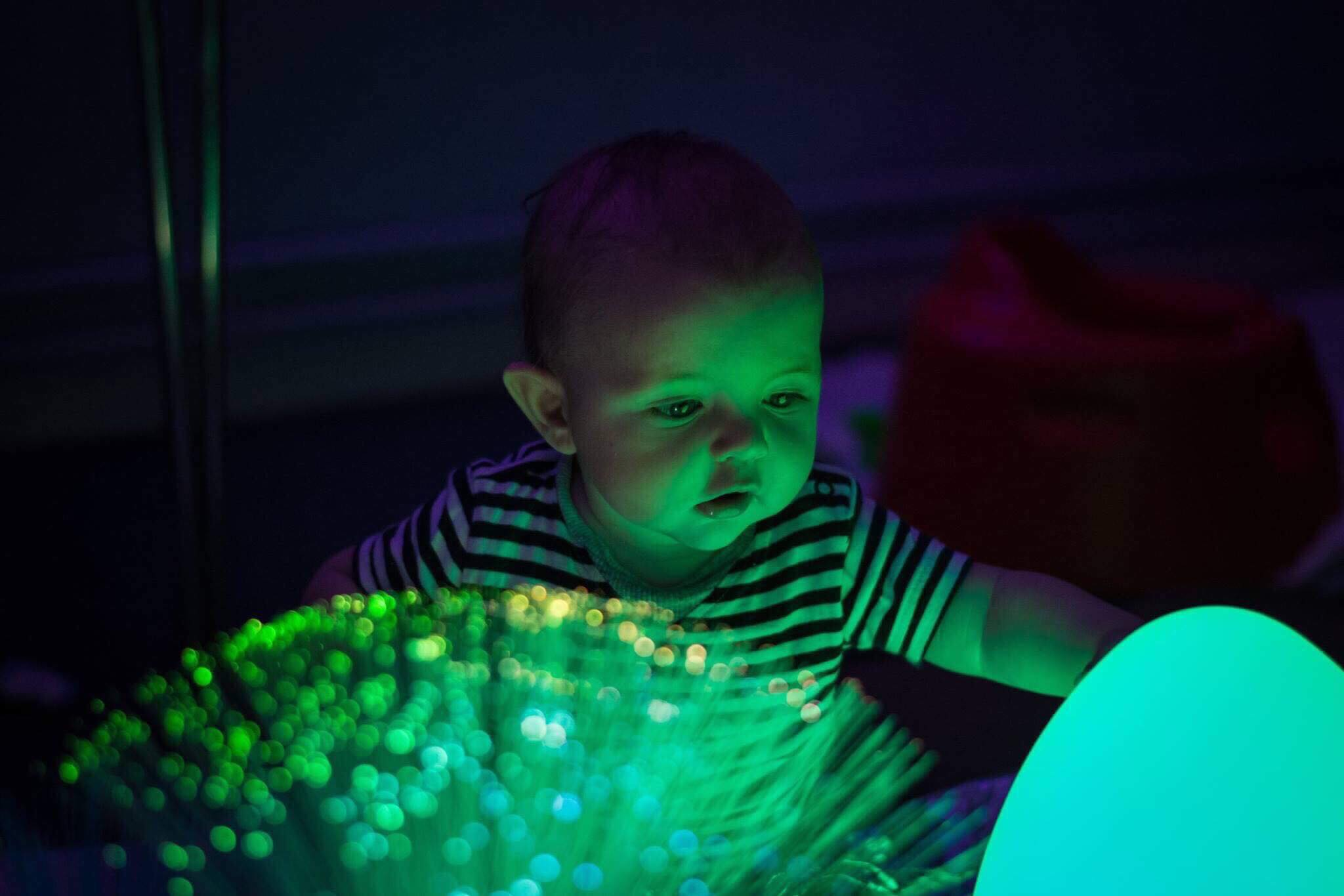 A little baby enjoys some sensory input at Little Glow in Mansfield