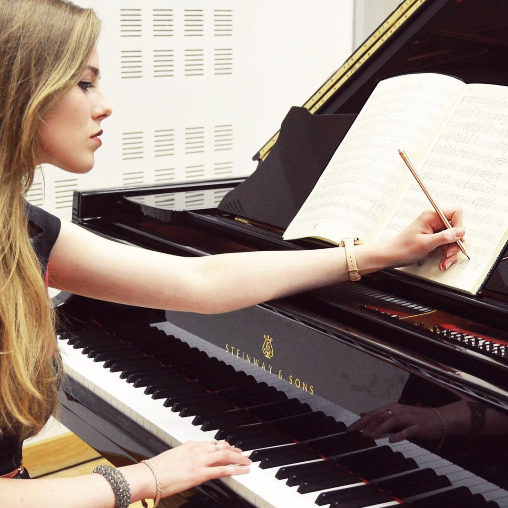 Grace-Evangeline Mason composing.png