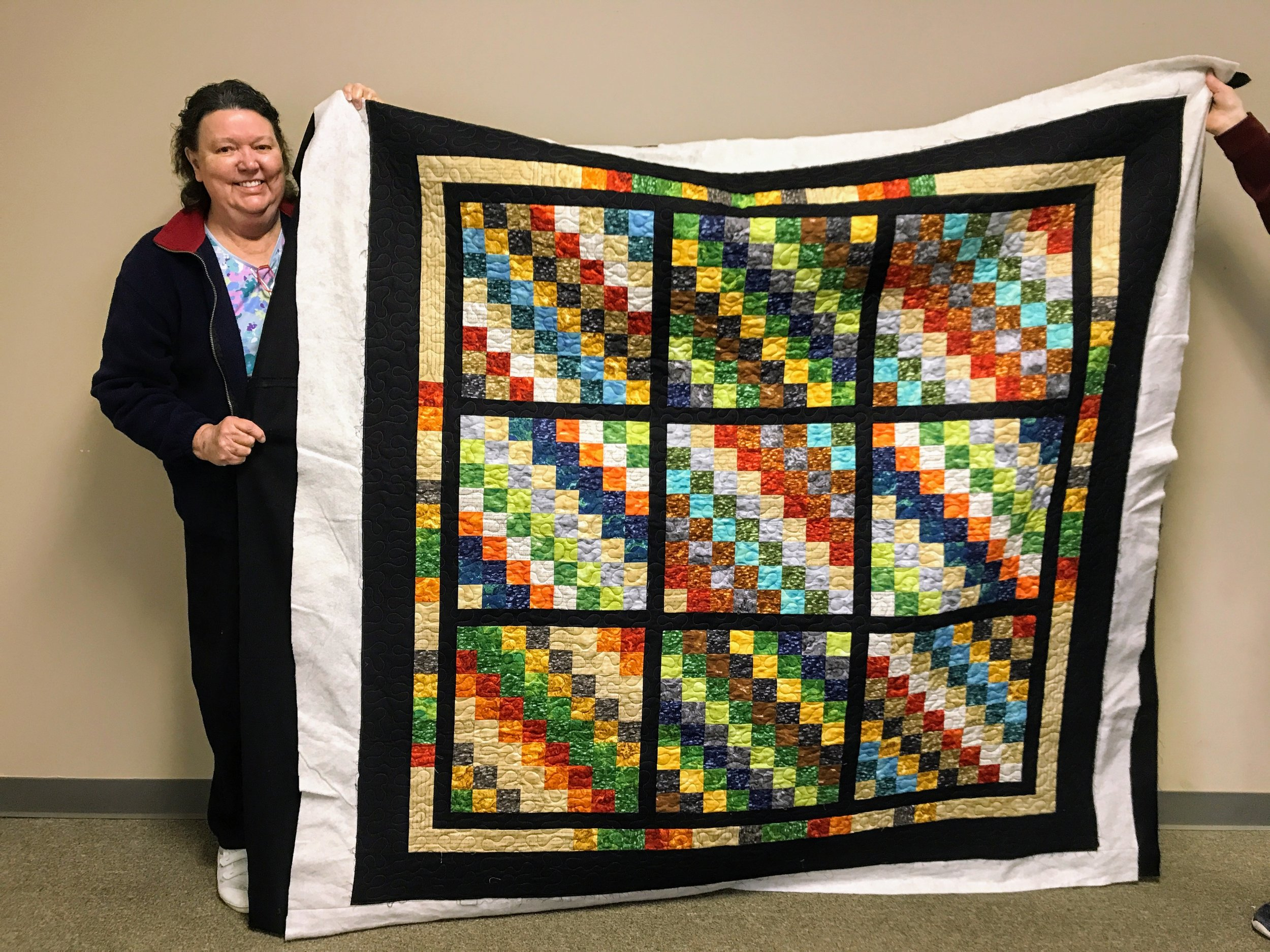 Beverly made this top and quilted it for a Habitat homeowner.
