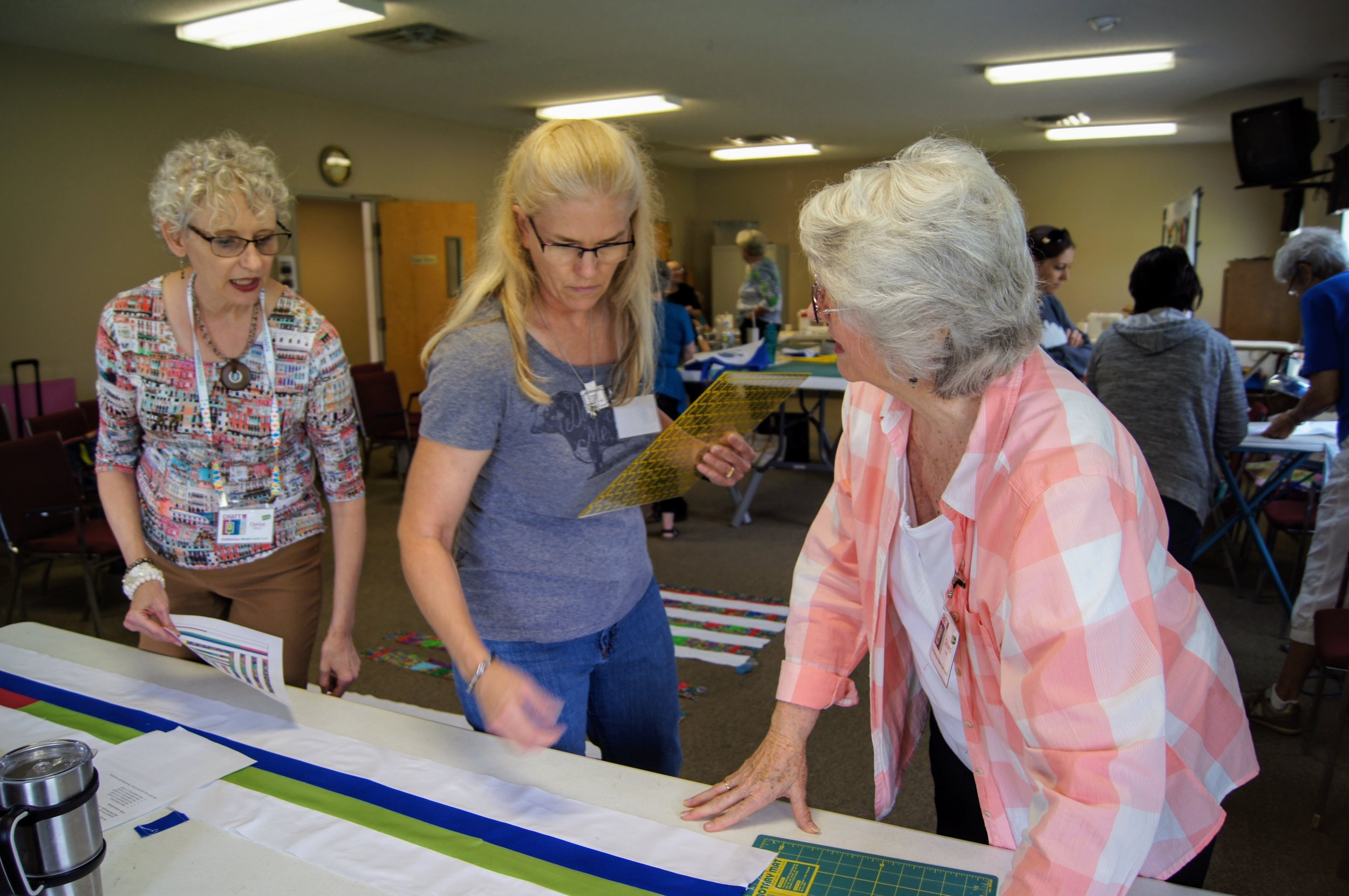 Denise, Sara and Delores prepare the strips of solids