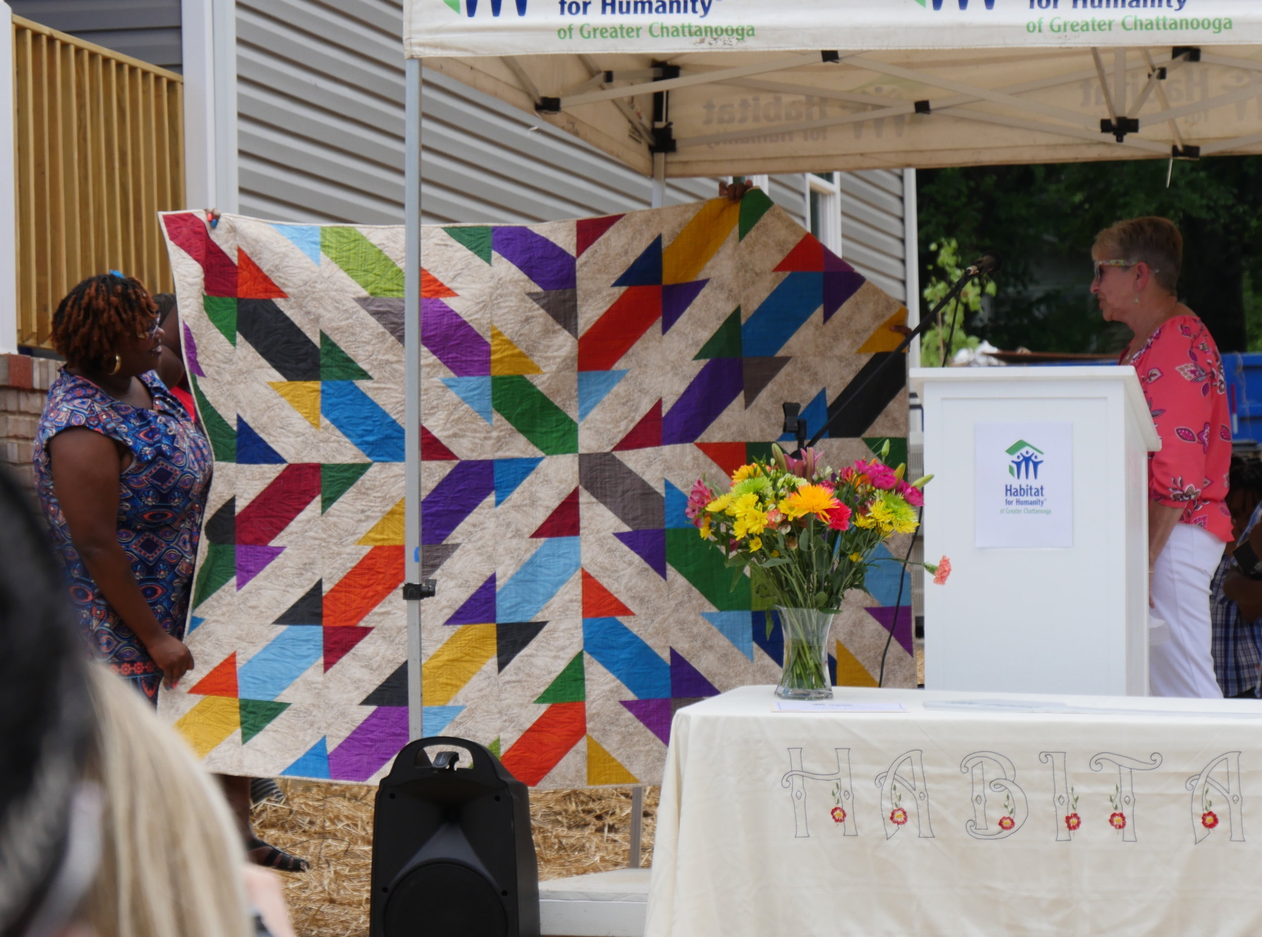 Fanetta (left) loves her colorful quilt. Photo courtesy of Habitat for Humanity of Greater Chattanooga.
