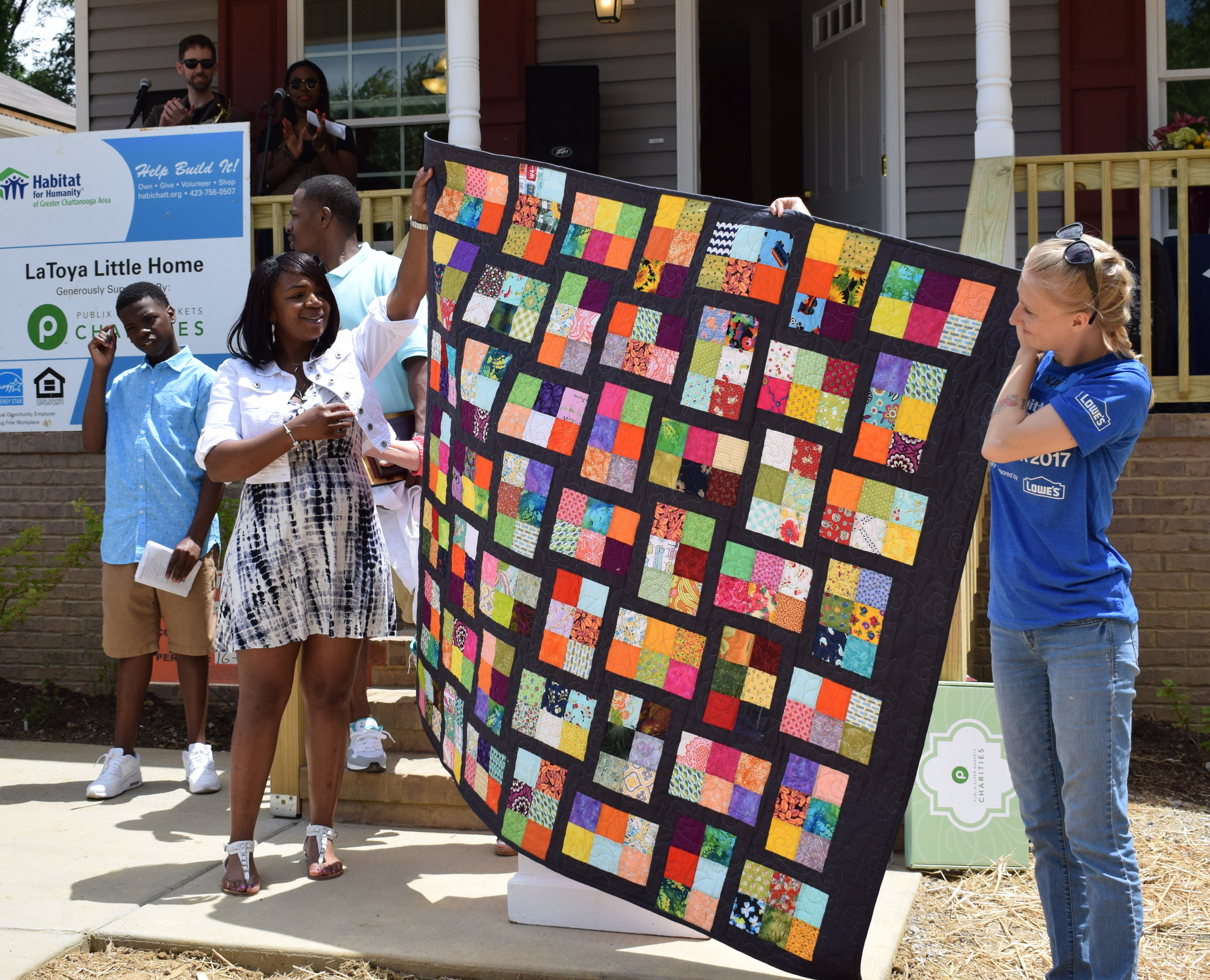 LaToya (left) and her bricks block quilt.Photo courtesy of Habitat for Humanity of Greater Chattanooga.