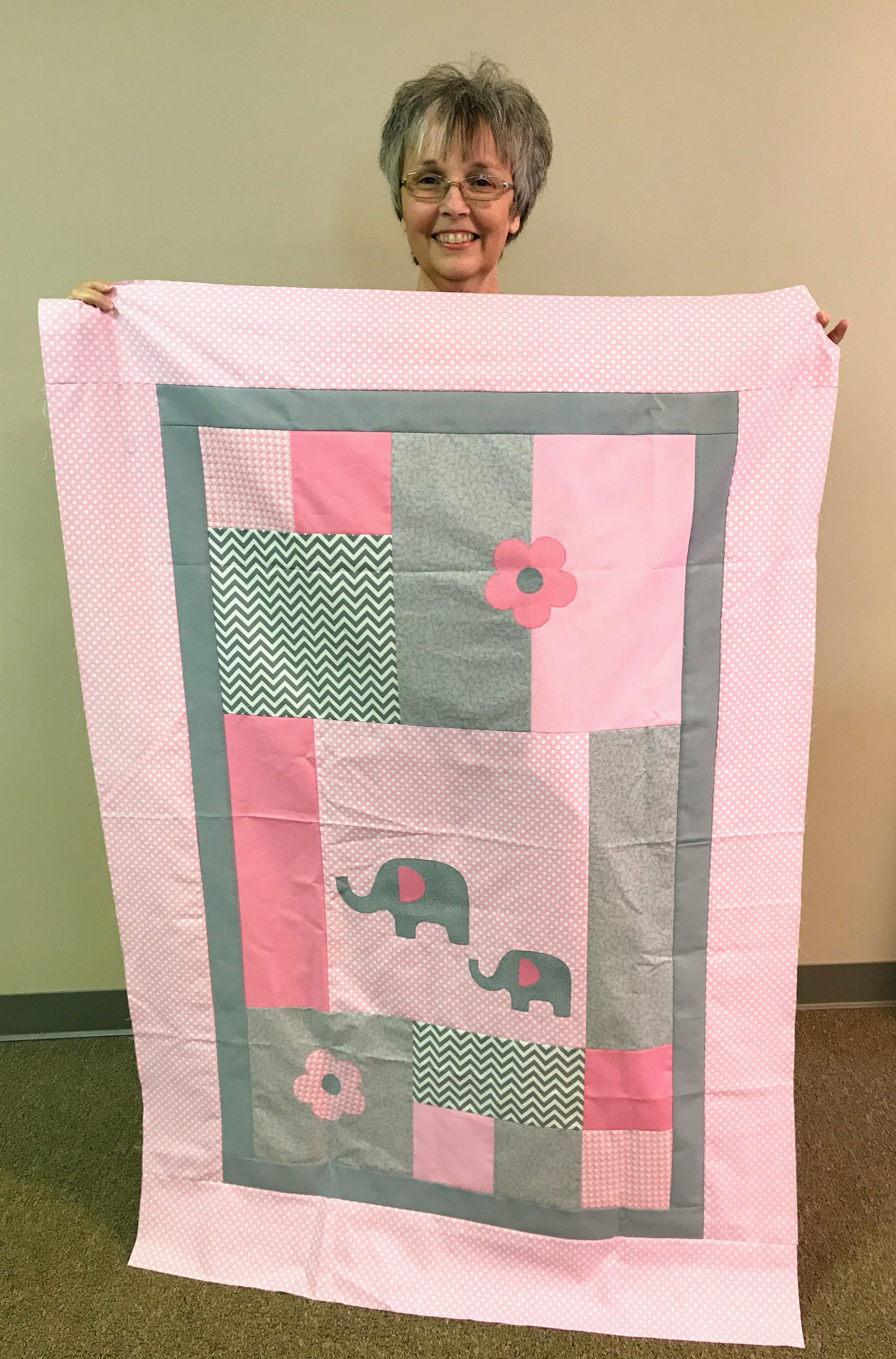 Patricia Steadman and her delightful baby quilt