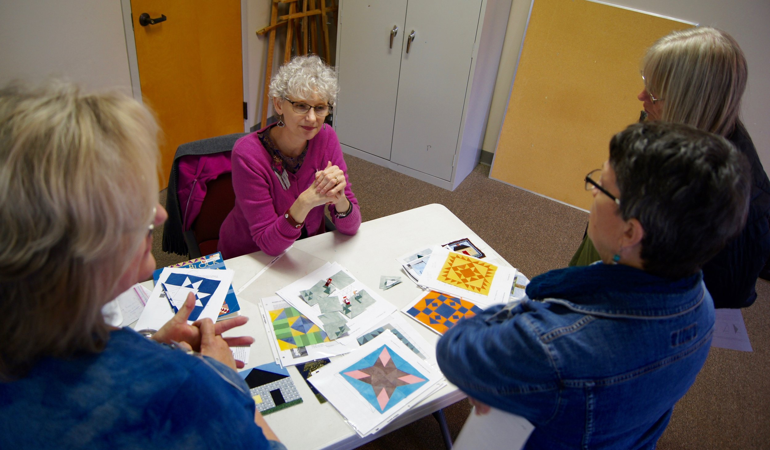 Denise Ohlman showed members several examples of complex paper piecing patterns.