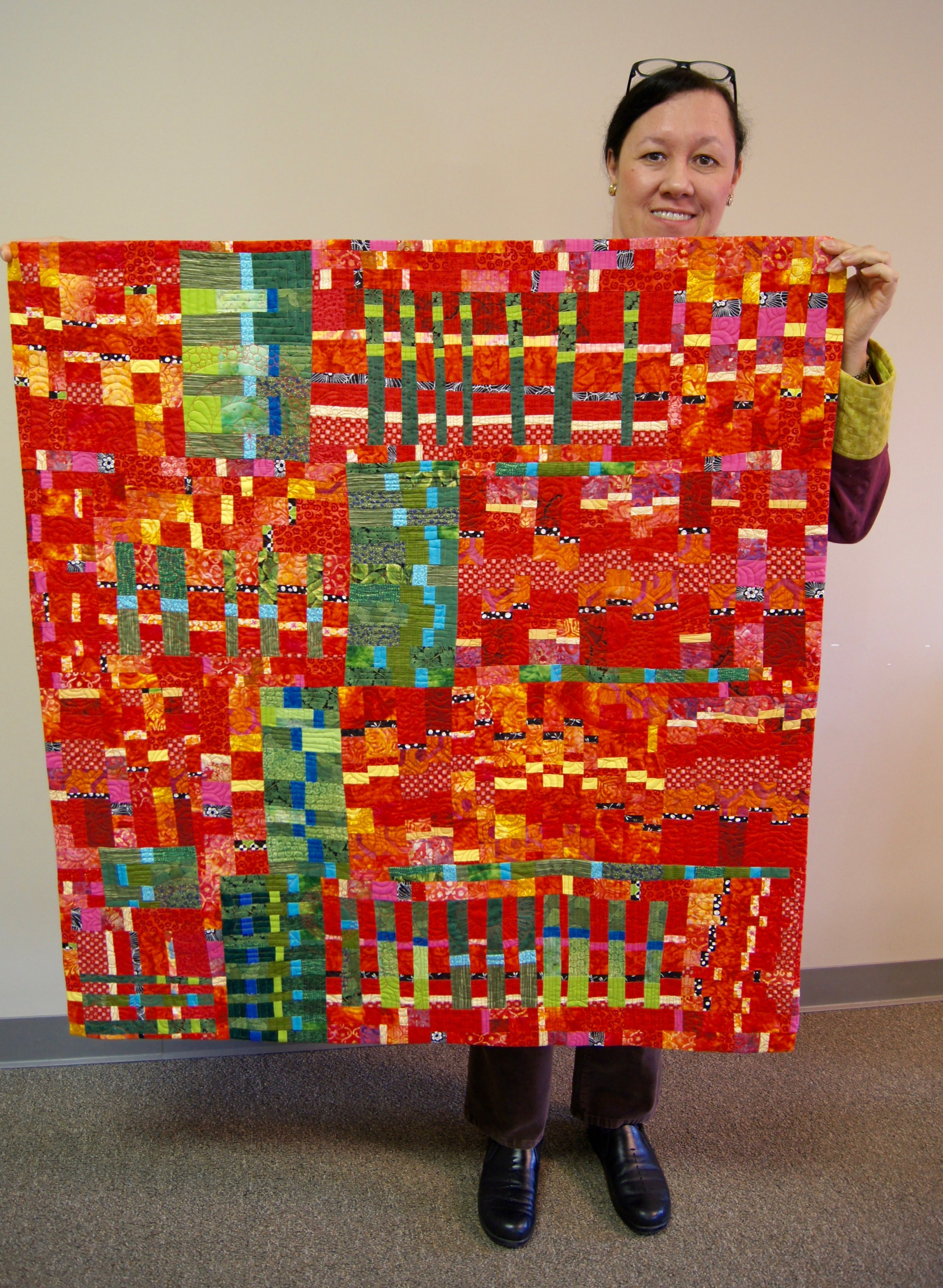 """Veronica Hofman-Ortega's """"Guitar Strings Improv"""" quilt, which is featured in a book by Sherri Lynn Wood"""