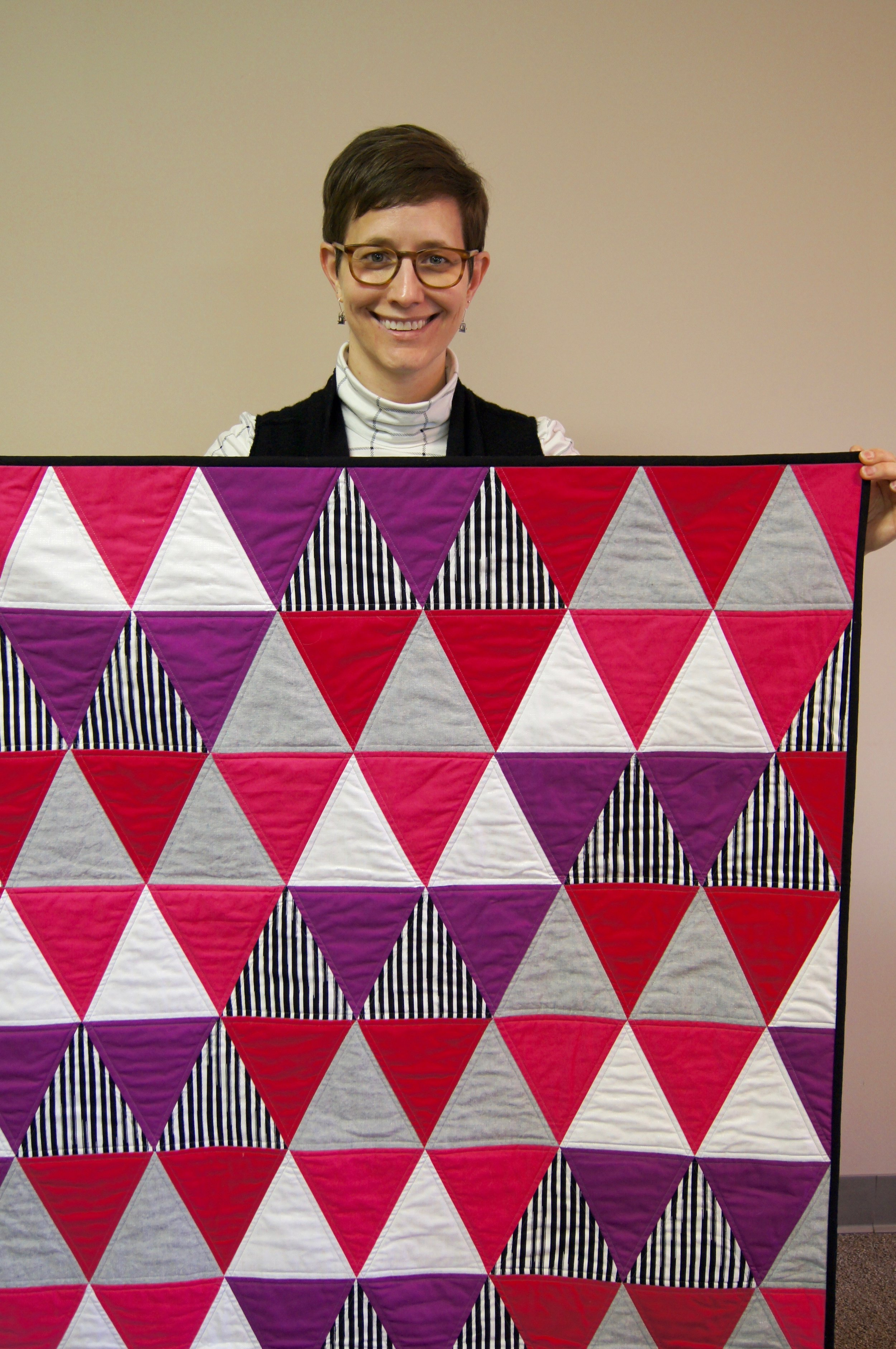 Kelly Spell's modern triangle baby quilt