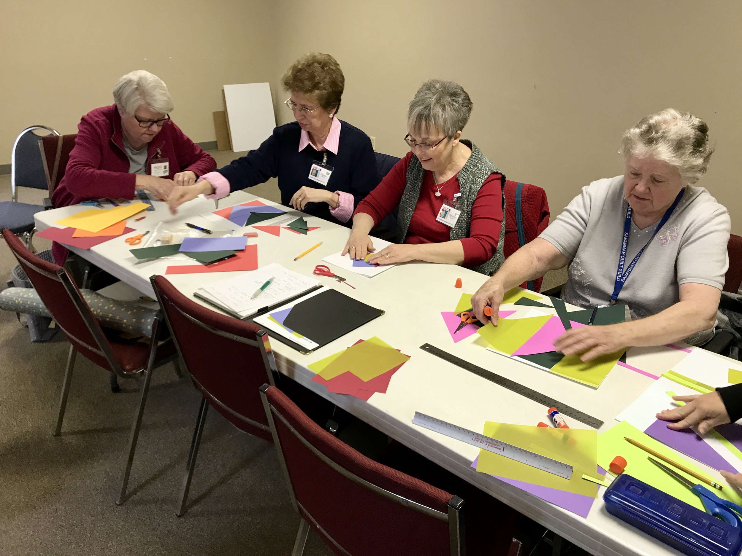 Jean, Theresa, Patricia, and visitor Helen work on their paper blocks