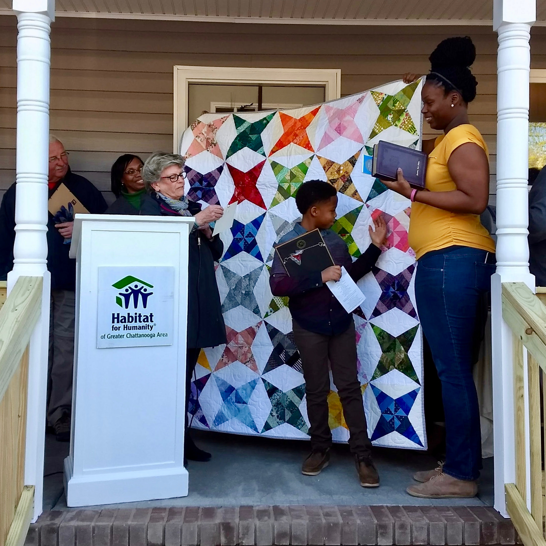 Shan Melvin (right) receives our paper-pieced star quilt at the March 22 dedication ceremony. Photo courtesy of Habitat for Humanity of Greater Chattanooga.