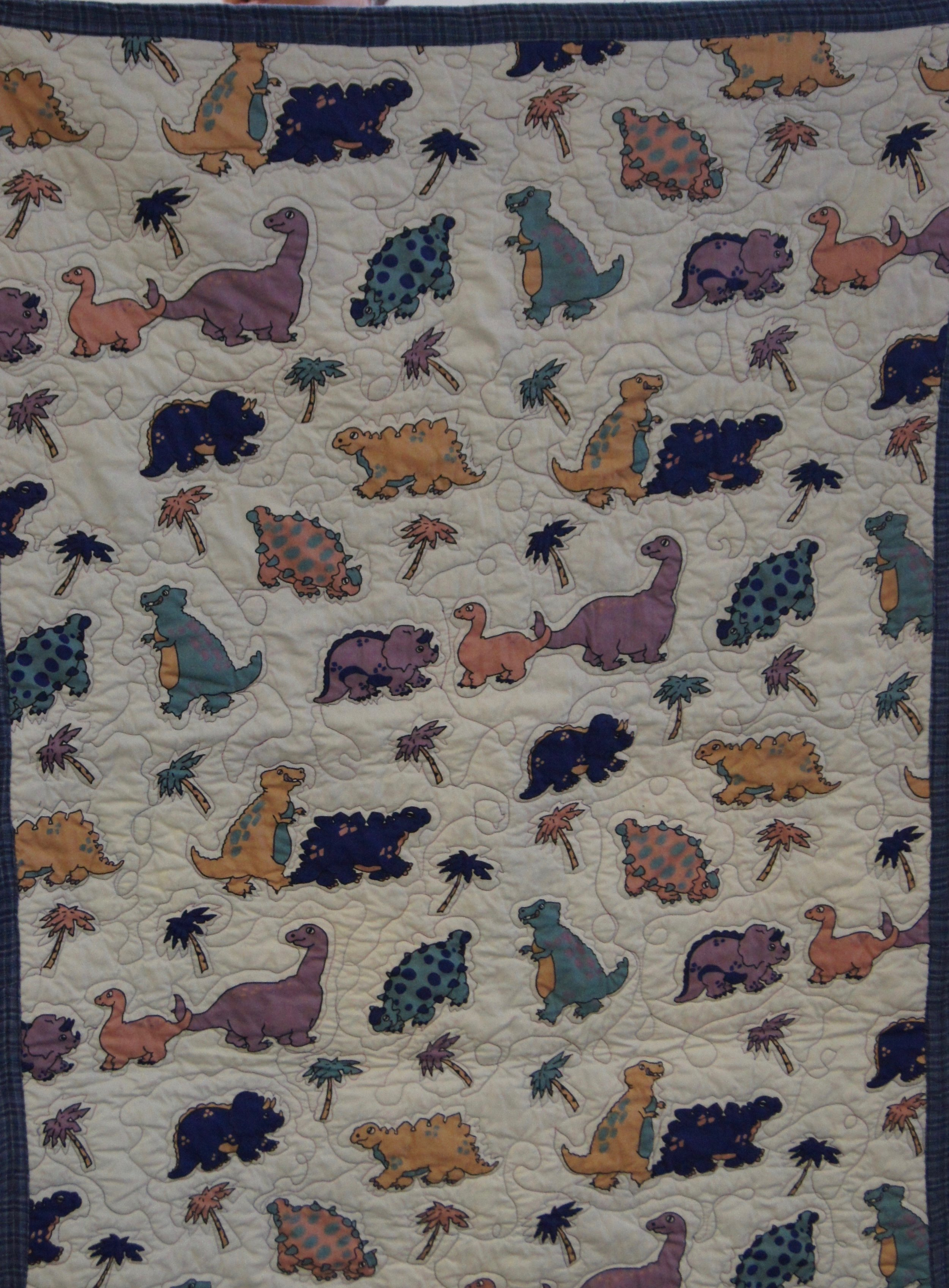 Child's dinosaur quilt by Michele Leonard