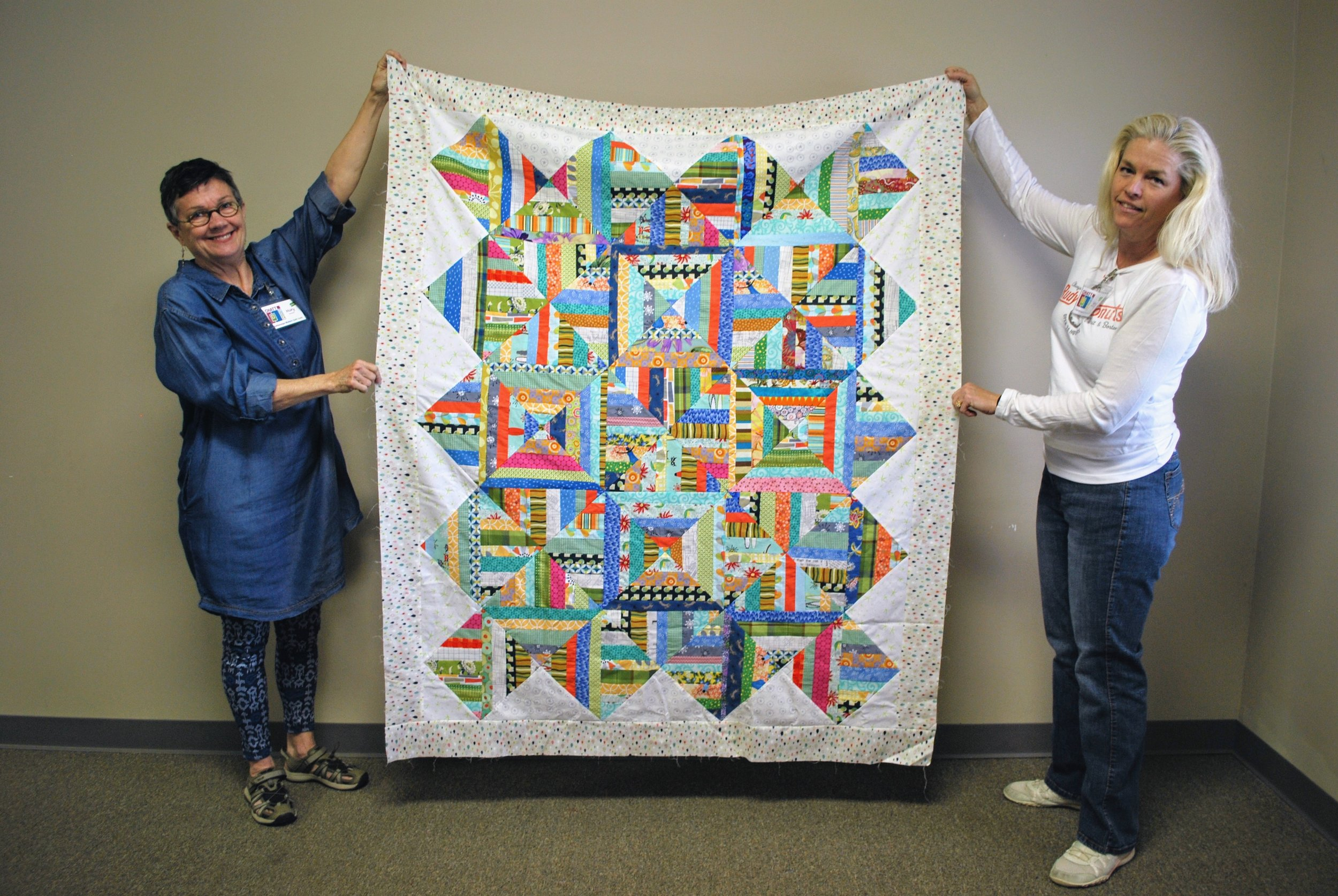 Mary Keasler (left) made this top to donate to Sara Bradshaw's Operation Underground Railroad effort.