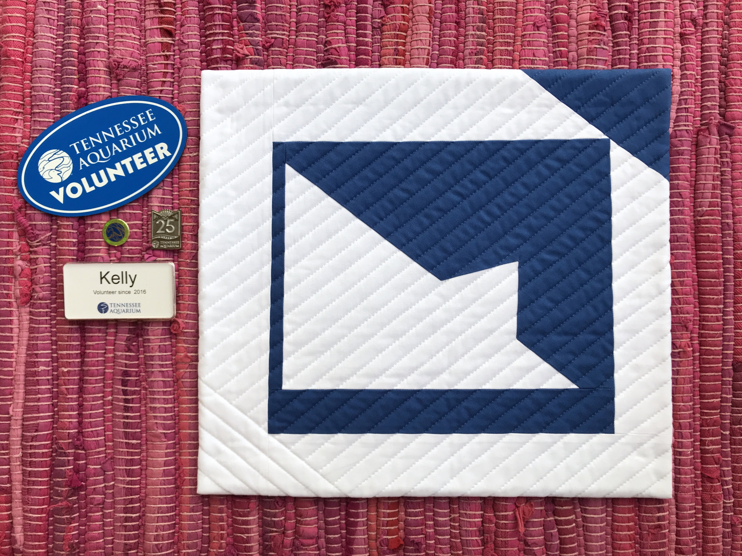 "Kelly Spell's mini quilt entitled ""Peaks of Change"" was inspired by the roofline of Tennessee Aquarium."