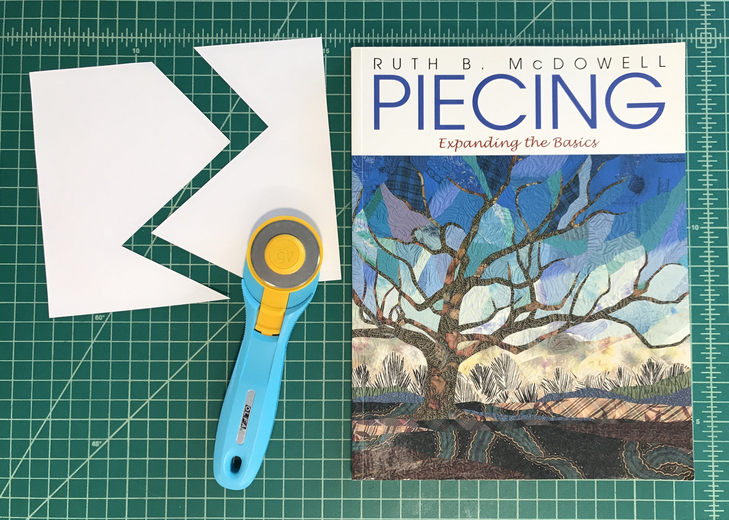 """Ruth McDowell's book """"Piecing: Expanding the Basics"""" is a great resource."""